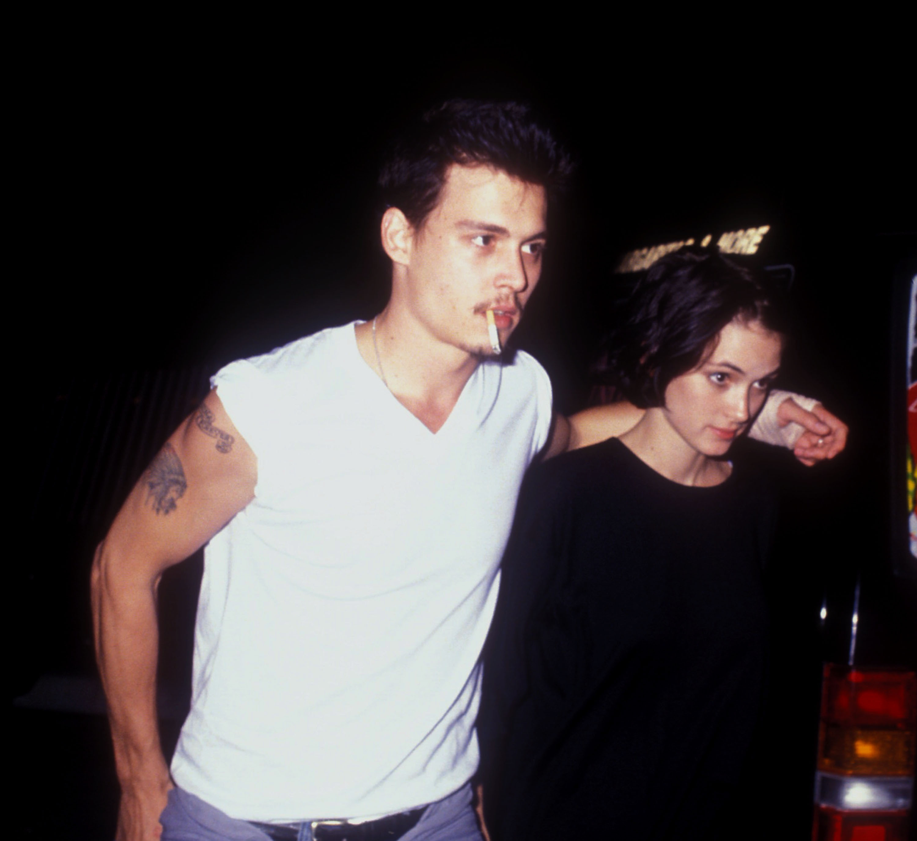 Johnny Depp and Winona Ryder are shown at Herb Ritts birthday party in 1990.