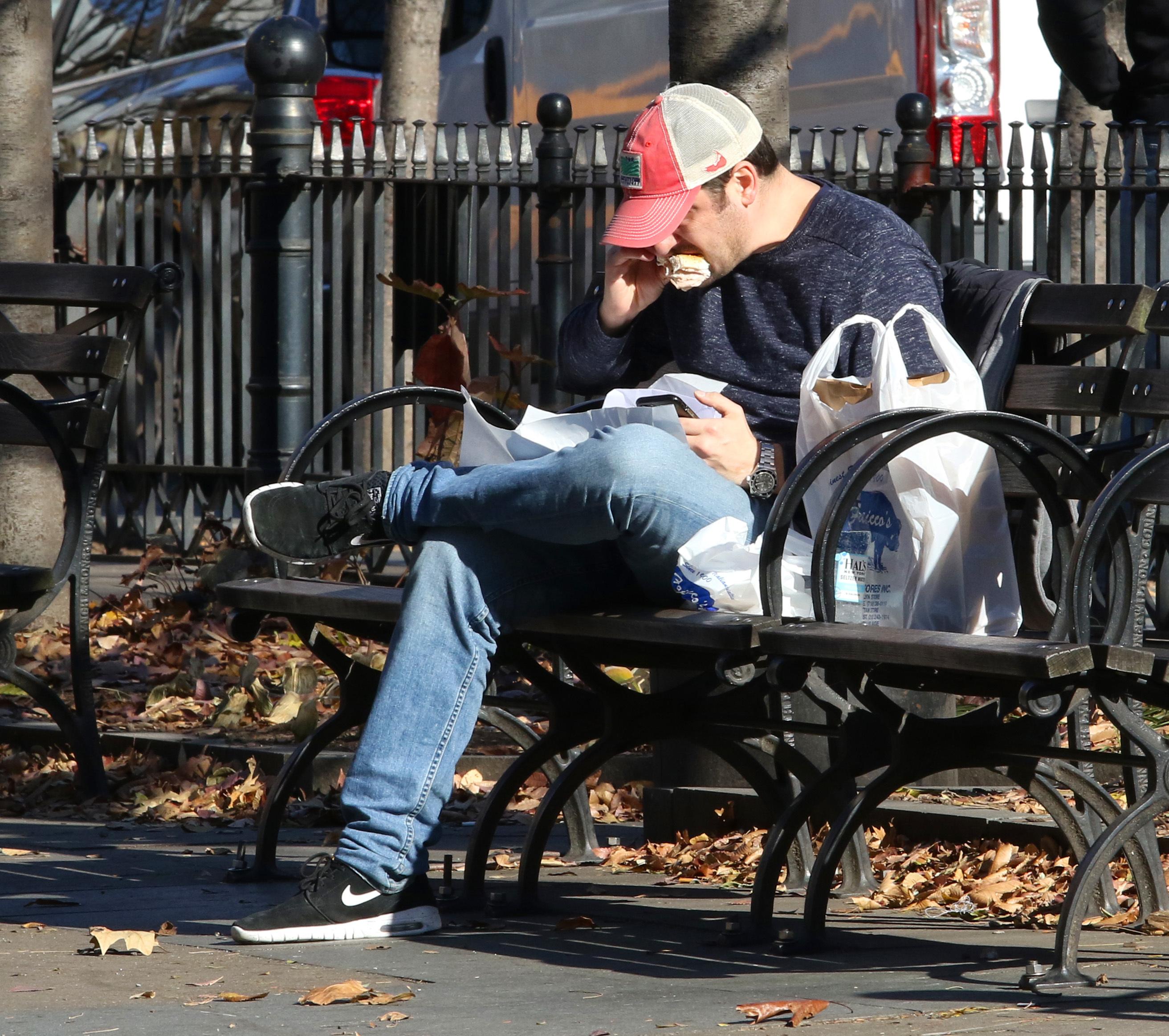 Jason Biggs enjoys eating a sandwich on a park bench in Manhattan's West Village Neighborhood in New York City on Nov. 29, 2017.