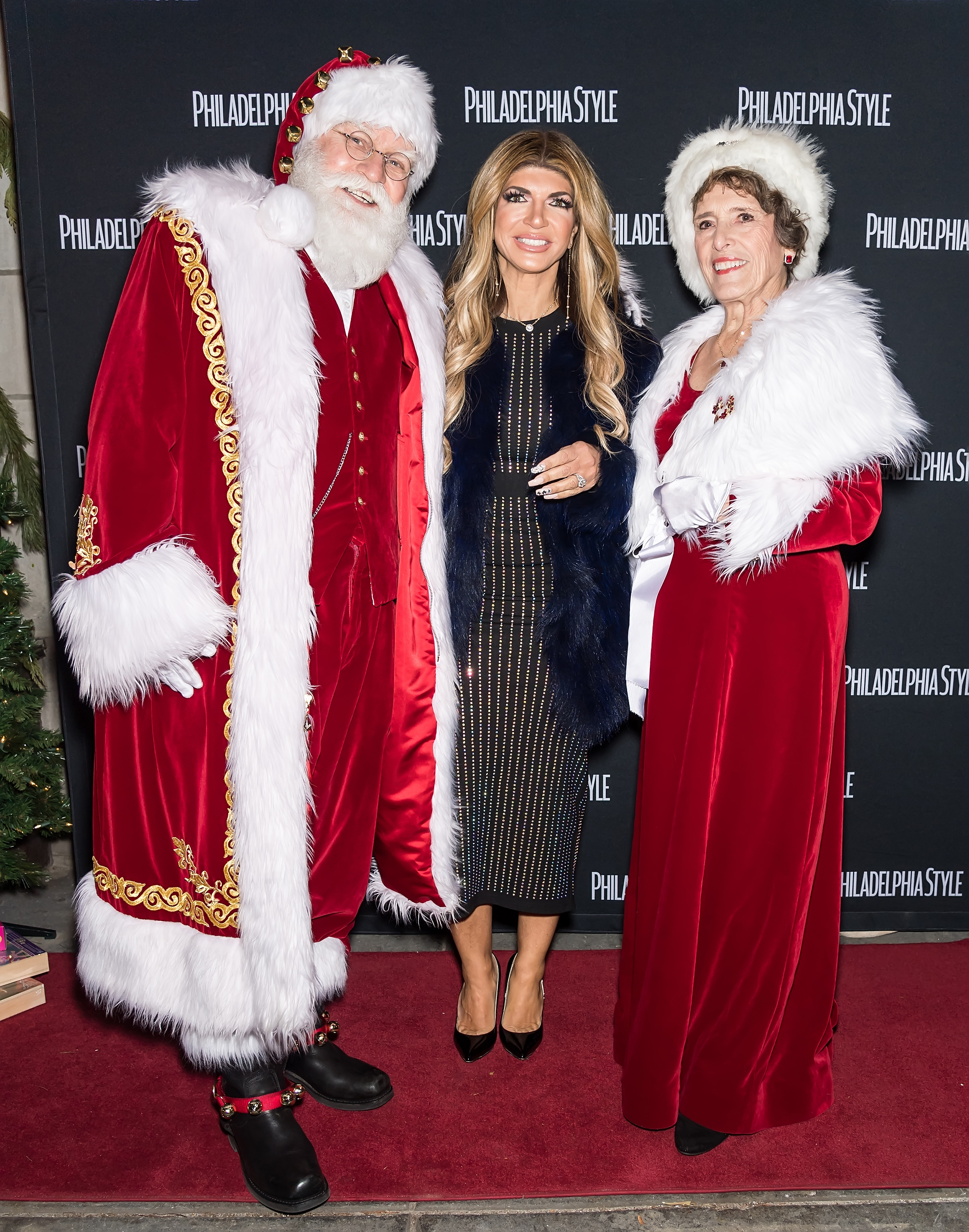 Teresa Giudice poses with Santa Claus and Mrs. Claus during 'Sleigh' A Toys for Tots Event and Meet & Greet in Philadelphia, Pennsylvania on Dec. 7, 2017.