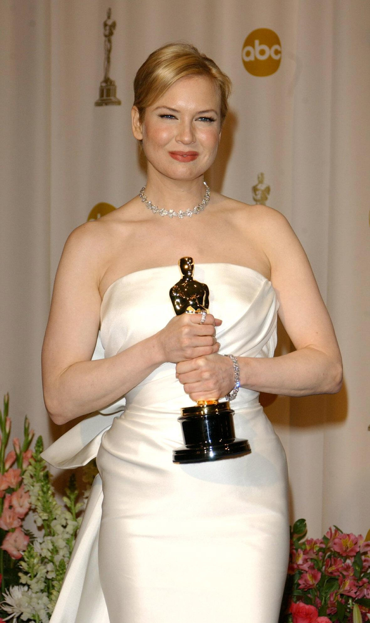 Actress Renee Zellweger with her Oscar for Best Actress in a Supporting Role at the Kodak Theatre in Los Angeles during the 76th Academy Awards in 2004.