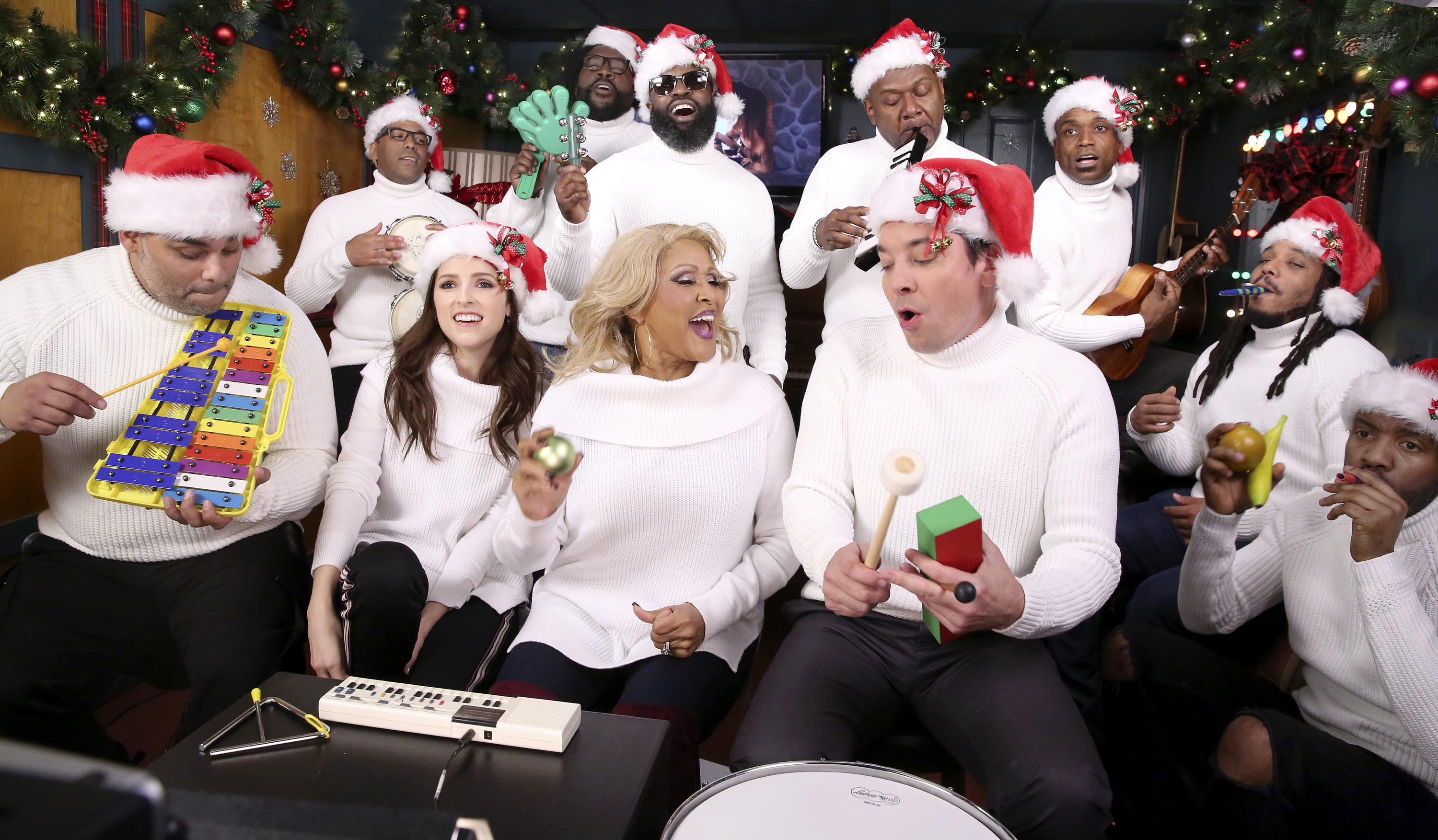 "Anna Kendrick, Darlene Love, and Jimmy Fallon appear with The Roots while performing ""'Christmas (Baby Please Come Home)' with Classroom Instruments"" on Dec. 18, 2017."