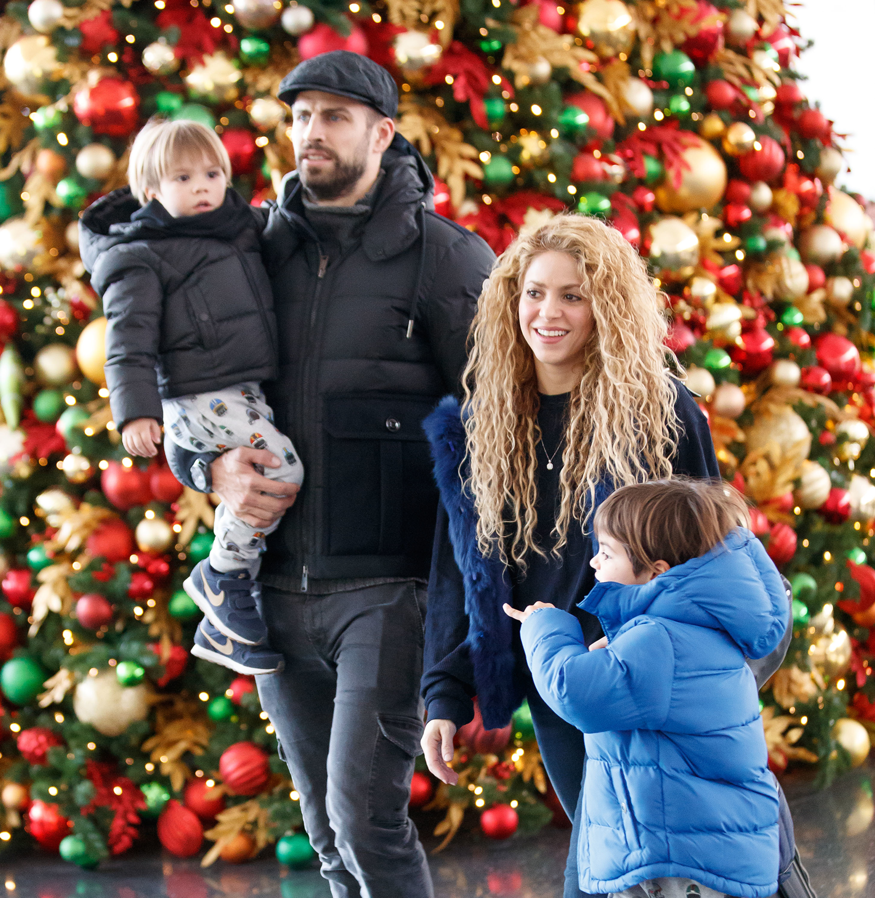 Shakira, Gerard Pique and their sons Milan and Sasha walk through the airport in New York on Dec. 24, 2017.