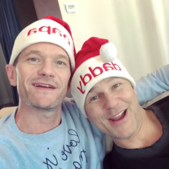 """""""Merry Christmas! Hope your day is full of tidings, toys, and toots. 🎅🏻 🦄 @dbelicious""""   Neil Patrick Harris, who posted this photo with David Burtka on Instagram on Dec. 25, 2017."""