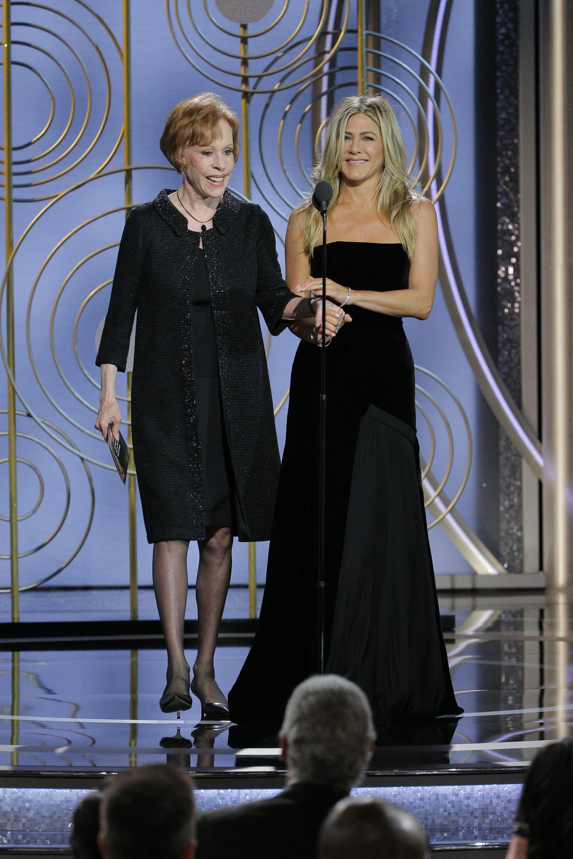 Presenters Carol Burnett and Jennifer Aniston appear on stage during the 75th Annual Golden Globe Awards on Jan. 7, 2018.