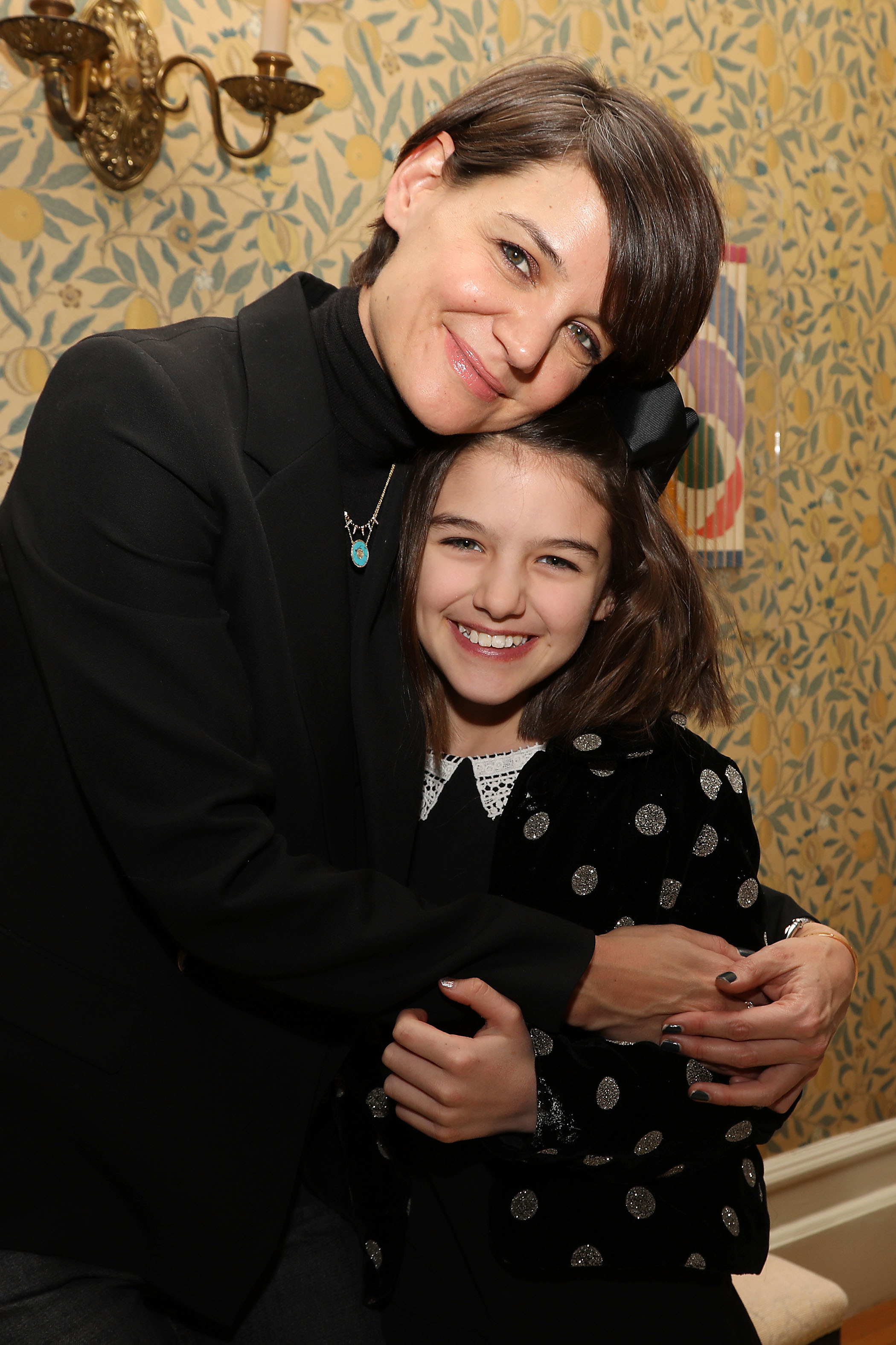 """Katie Holmes and daughter Suri Cruise attend a special screening of """"Long Strange Trip"""" in New York City on Jan. 7, 2018."""
