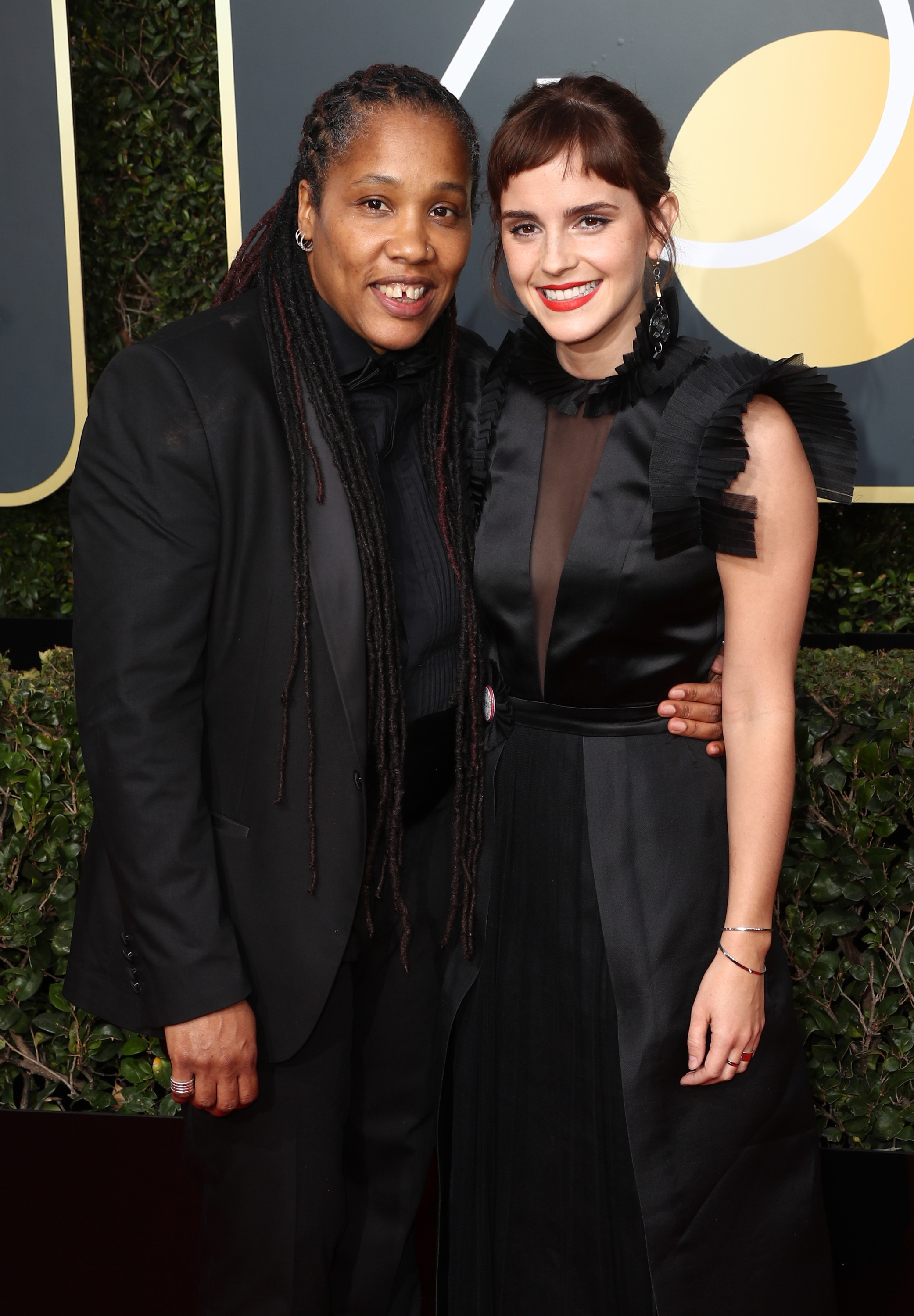Emma Watson and Marai Larasi, executive director of Imkaan, a British network of organizations working to end violence against black and minority women, attend The 75th Annual Golden Globe Awards at The Beverly Hilton Hotel in Beverly Hills, California on Jan. 7, 2018.