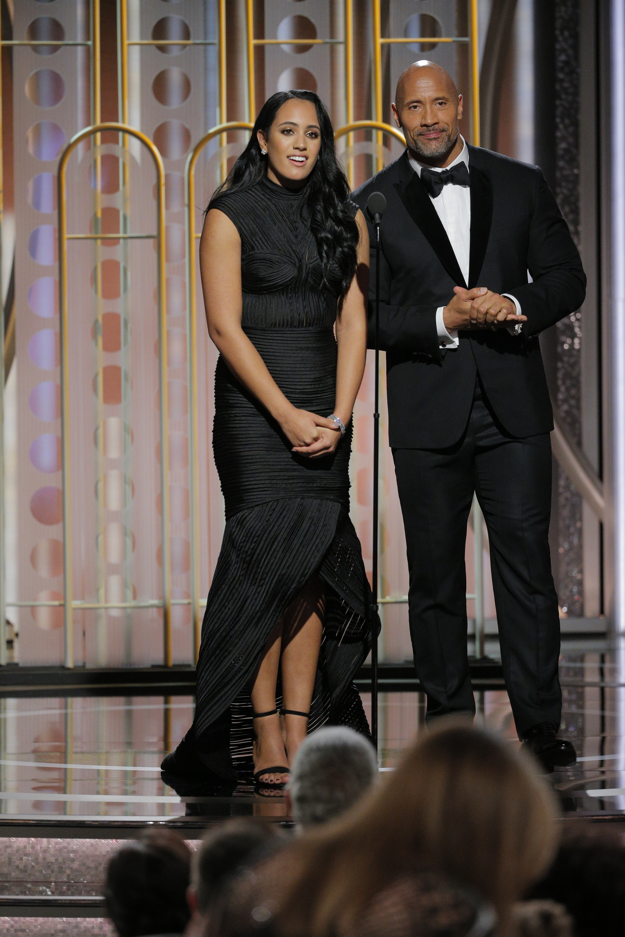 Golden Globe Ambassador  Simone Garcia Johnson and her father, Dwayne Johnson, speak onstage during the 75th Annual Golden Globe Awards at the Beverly Hilton hotel in Beverly Hills on Jan. 7, 2018.