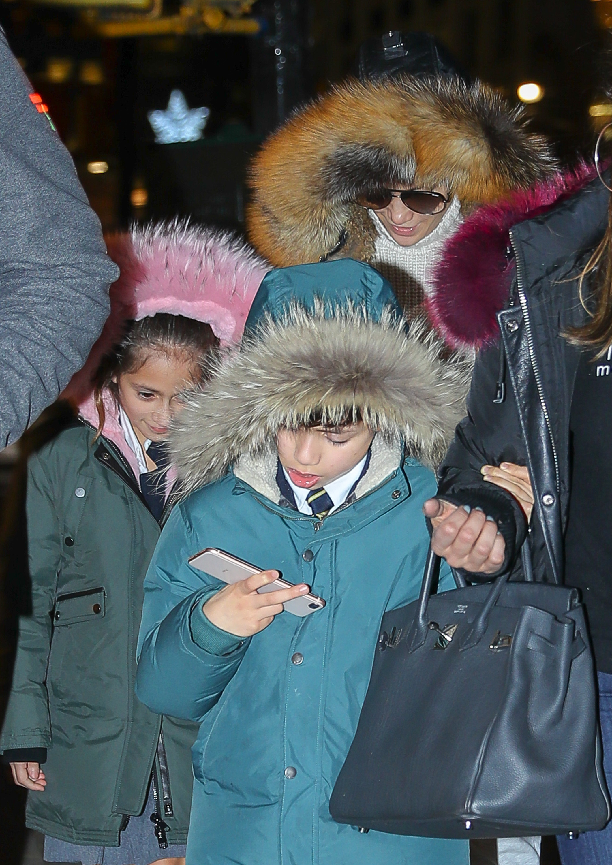 Jennifer Lopez and her kids wear hoodies in New York City on Dec. 19, 2017.