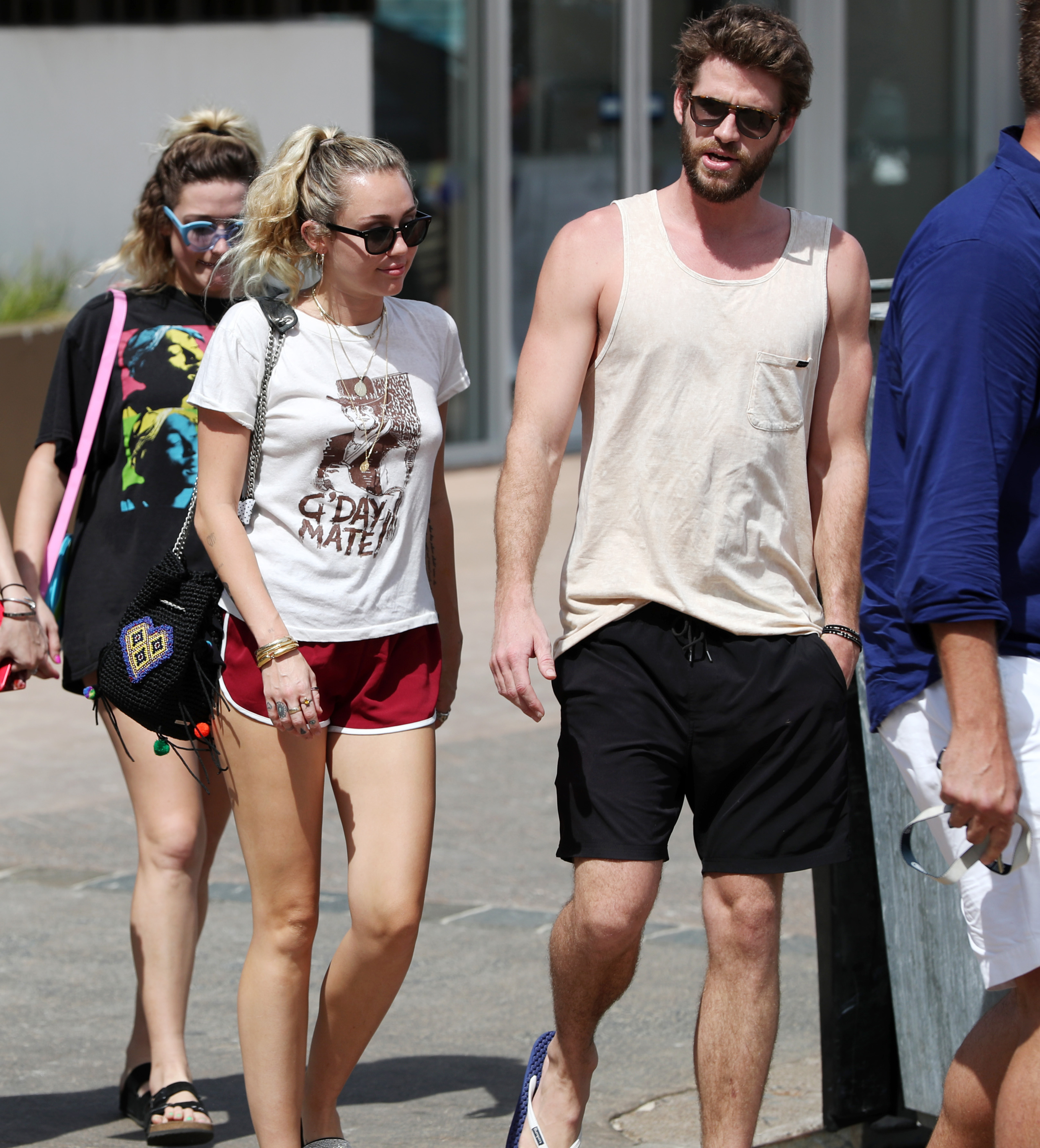 Miley Cyrus and Liam Hemsworth leave the Rick Shores restaurant in Burleigh Heads on the Gold Coast, Queensland, on Jan. 11, 2018.