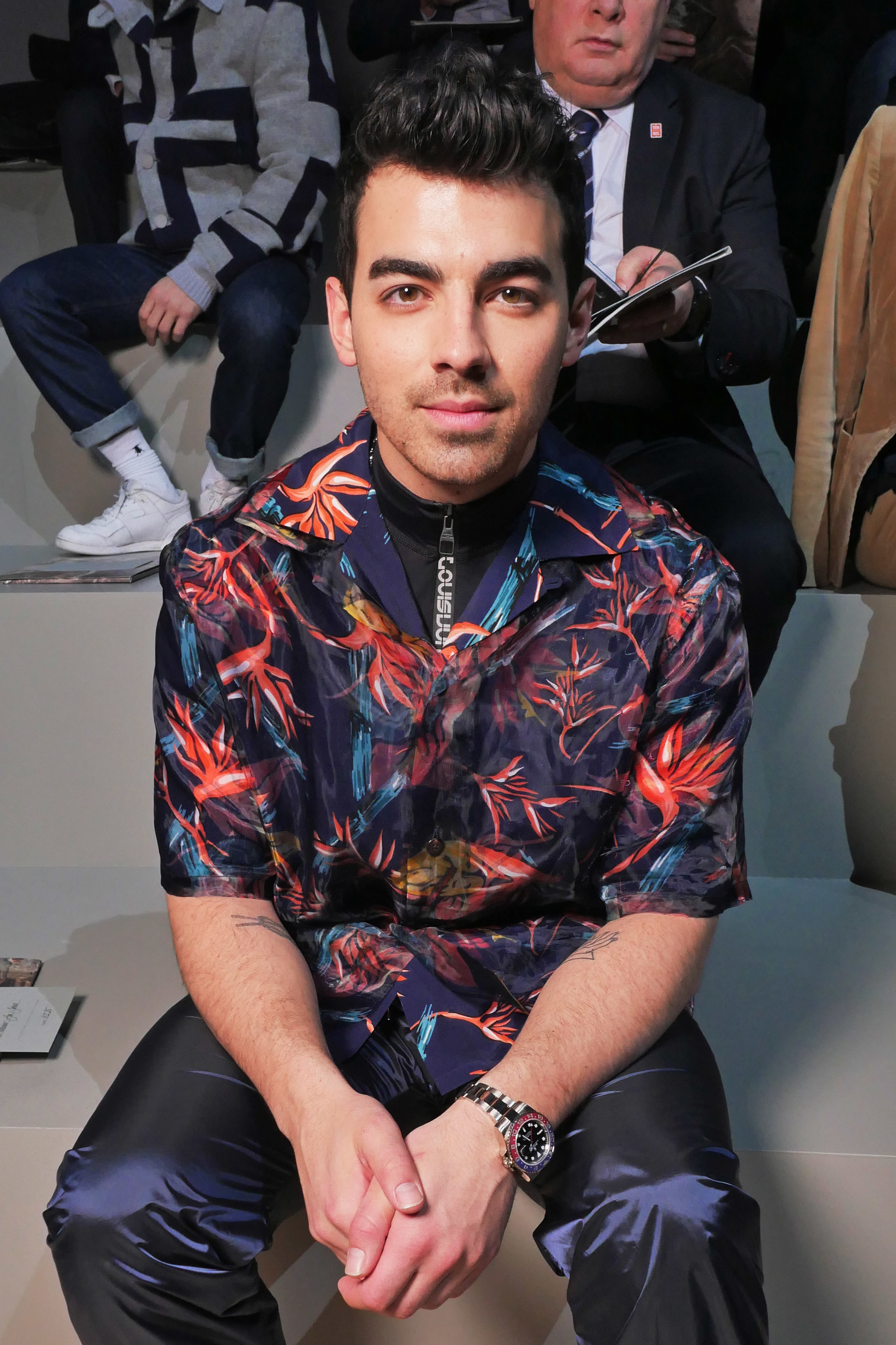 Joe Jonas sits in the front row of the Louis Vuitton show for Fall/Winter 2018 at Paris Fashion Week Men's on Jan. 18, 2018.