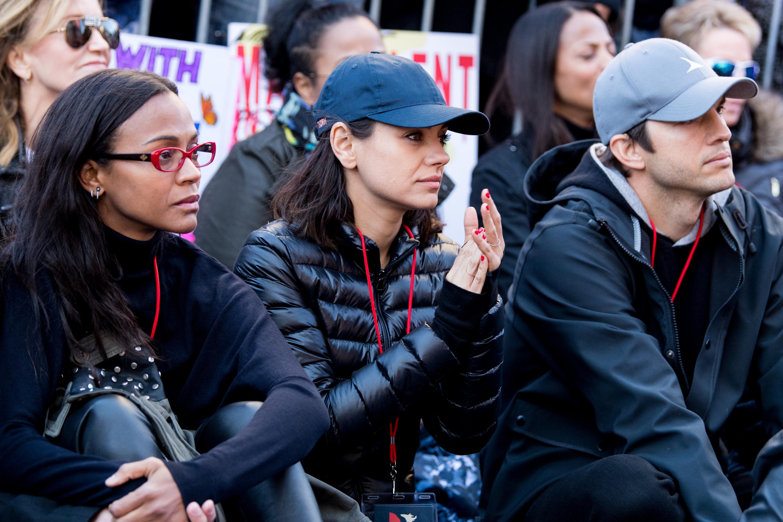Zoe Saldana, Mila Kunis and Ashton Kutcher appear the Women's March in Los Angeles on Jan. 20, 2018.