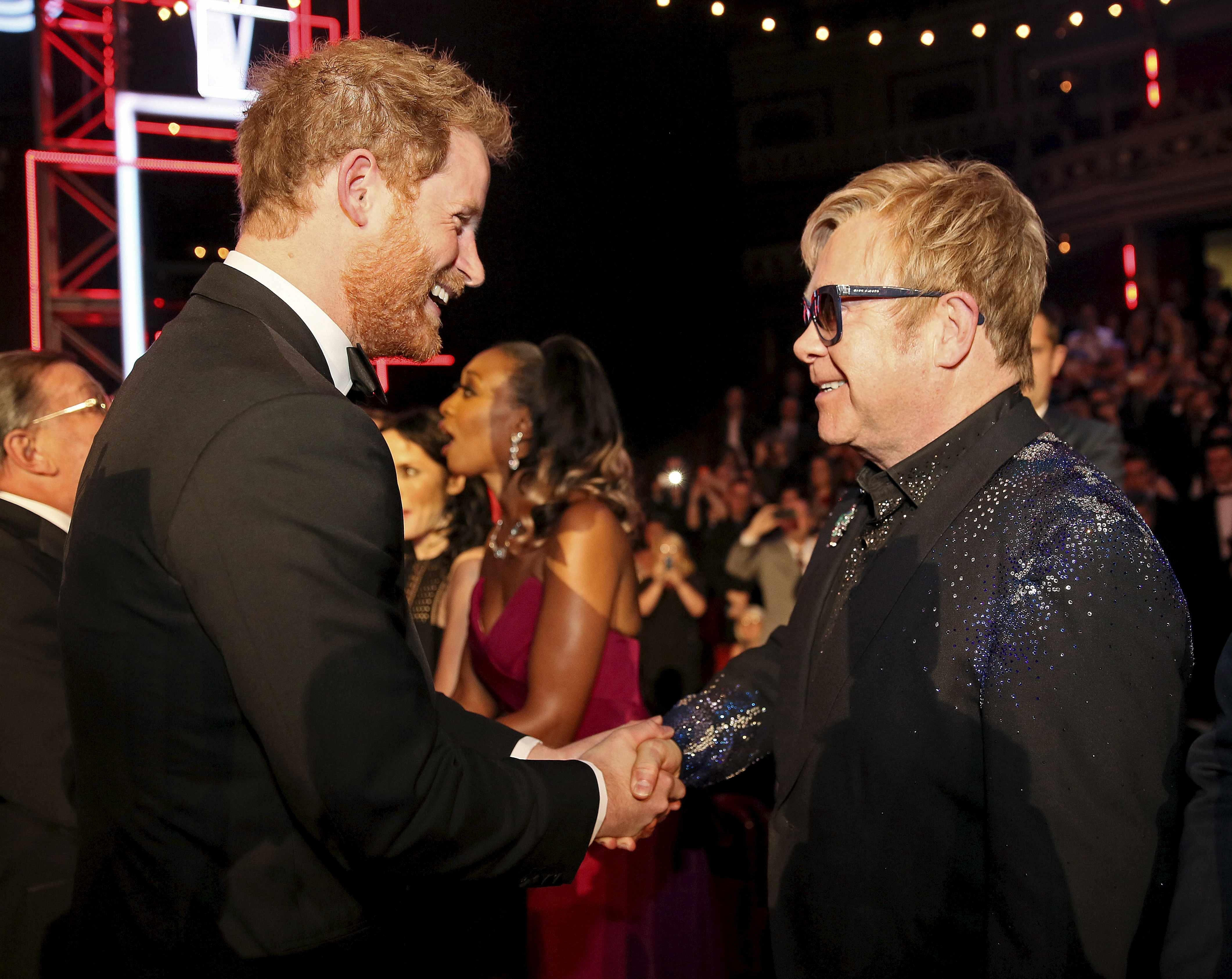 Prince Harry and Sir Elton John attend the Royal Variety Performance at Royal Albert Hall in London on Nov. 13, 2015.