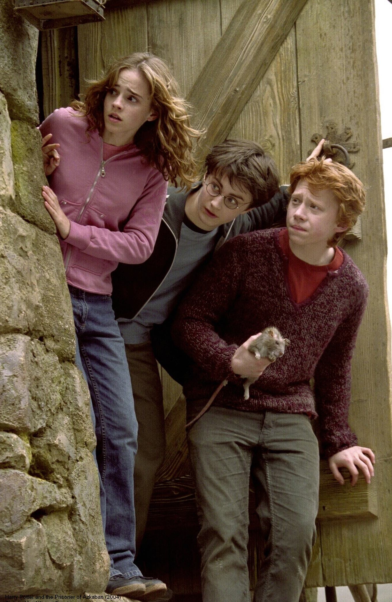 """Emma Watson (as Hermione Granger), Daniel Radcliffe (as Harry Potter), Rupert Grint (as Ron Weasley) are shown on the set of """"Harry Potter and the Prisoner of Azkaban"""" in 2004."""