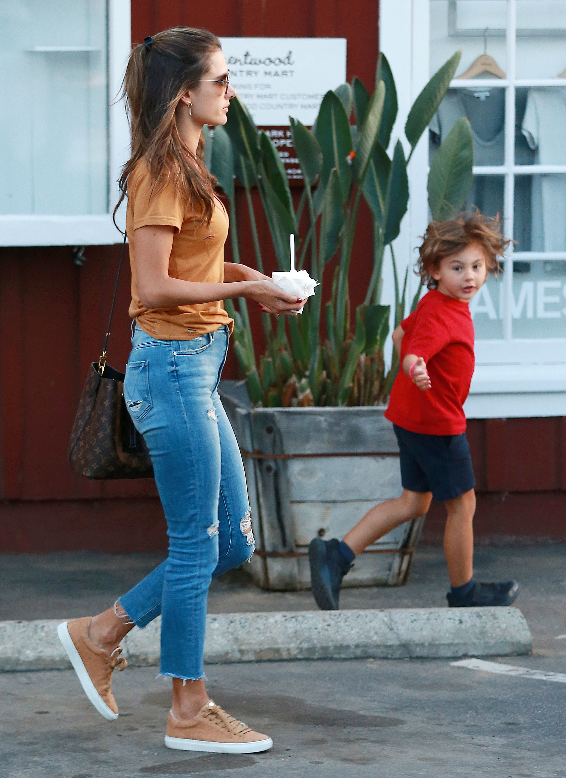 Alessandra Ambrosio and her son, Noah Mazur, visit the Brentwood Country Mart in Los Angeles on Jan. 30, 2018.