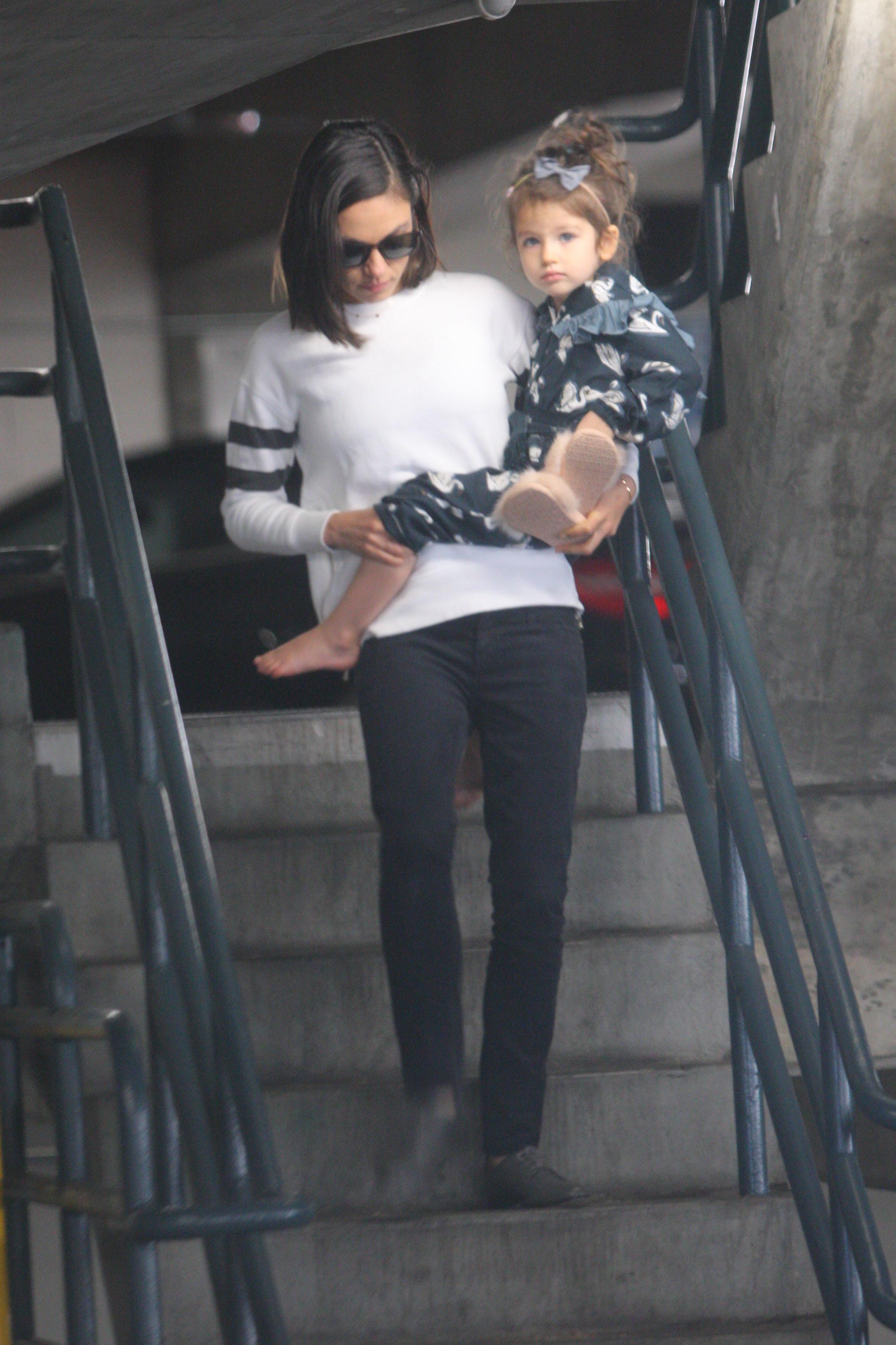 Mila Kunis carries her daughter, Wyatt Kutcher, in Los Angeles on Jan. 13, 2018.