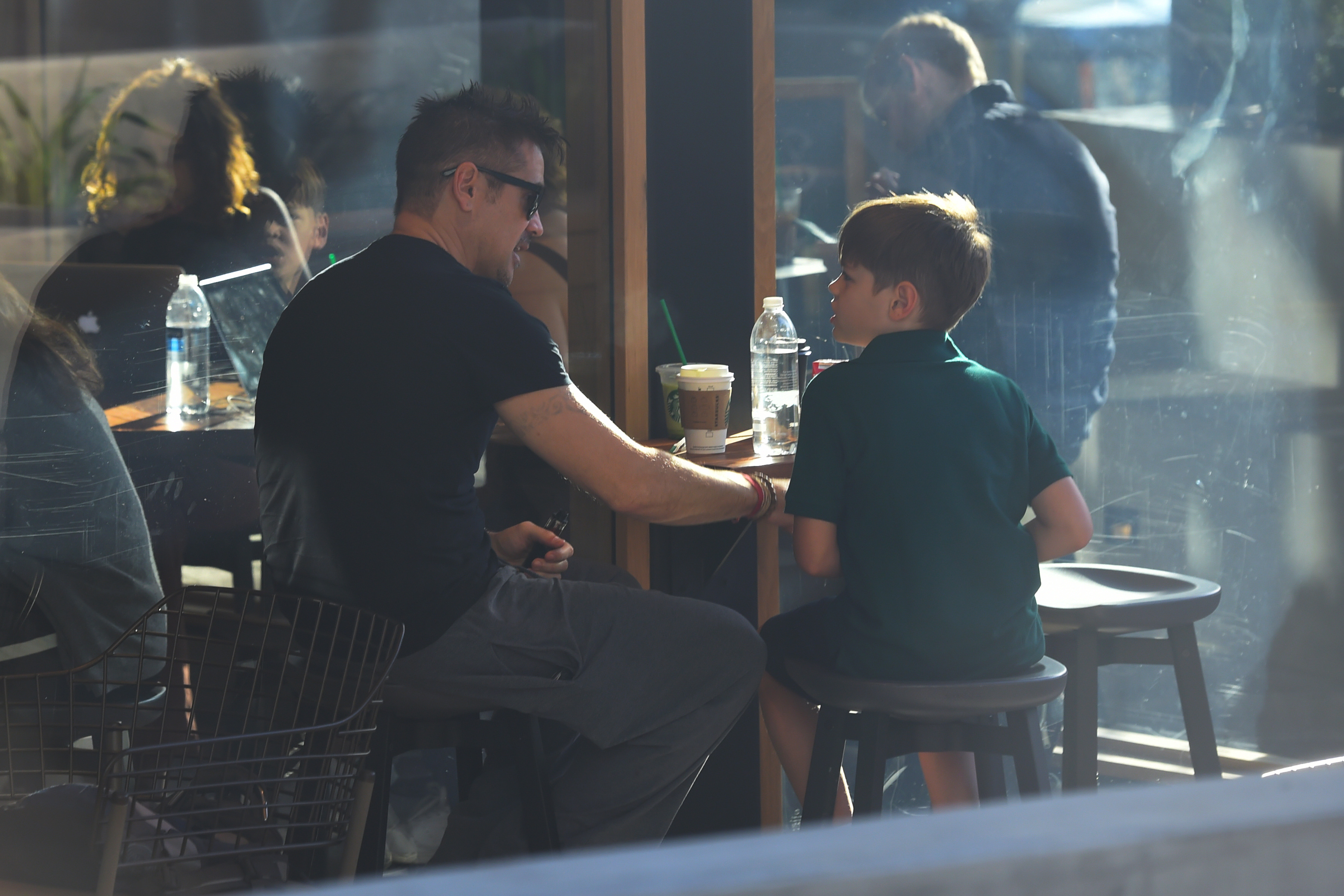 Colin Farrell visits a Starbucks in Los Angeles with one of his two sons on Jan. 17, 2018.