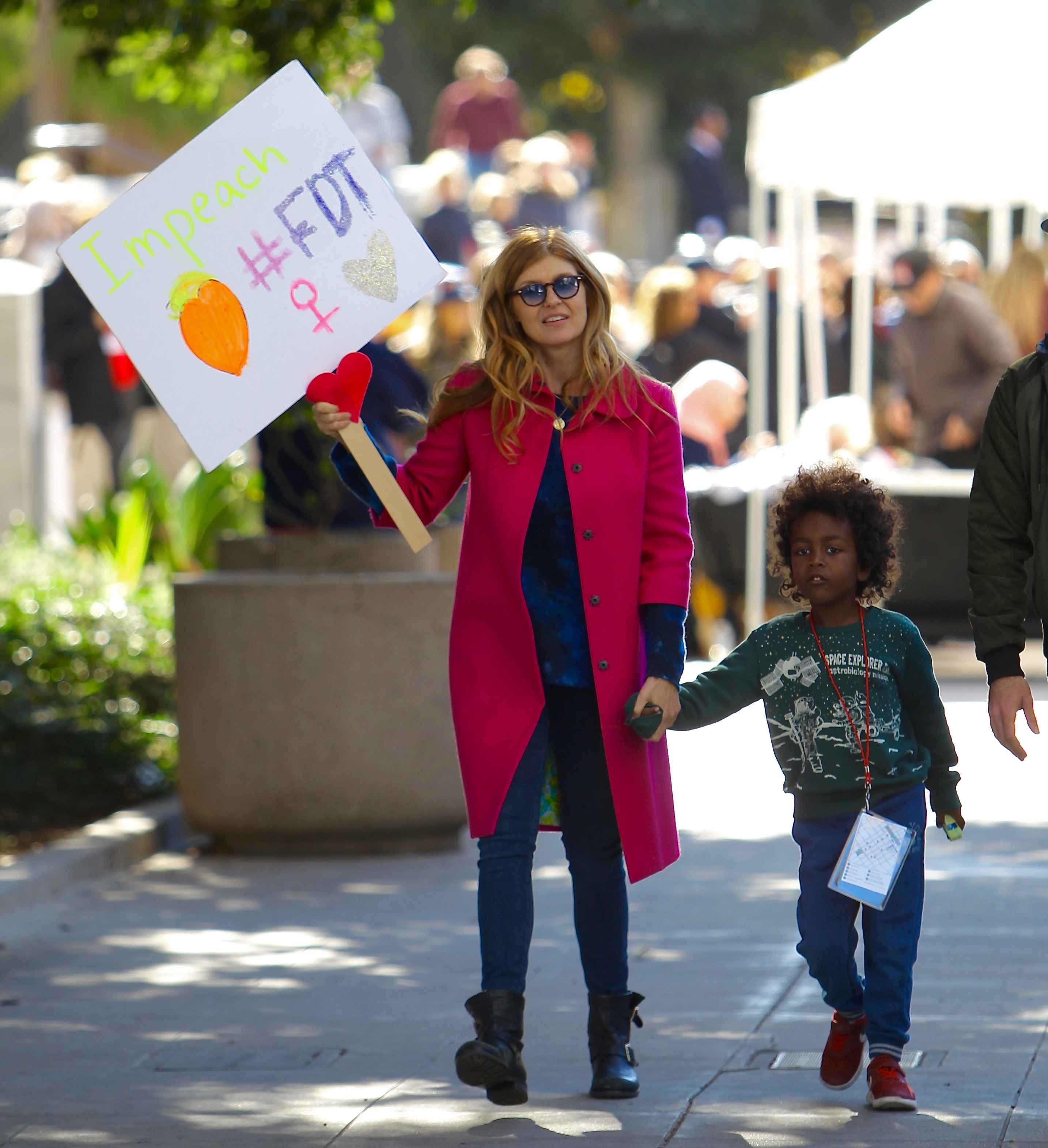 Connie Britton and her son, Eyob, attend the Women's March in Los Angeles on Jan. 20, 2018.