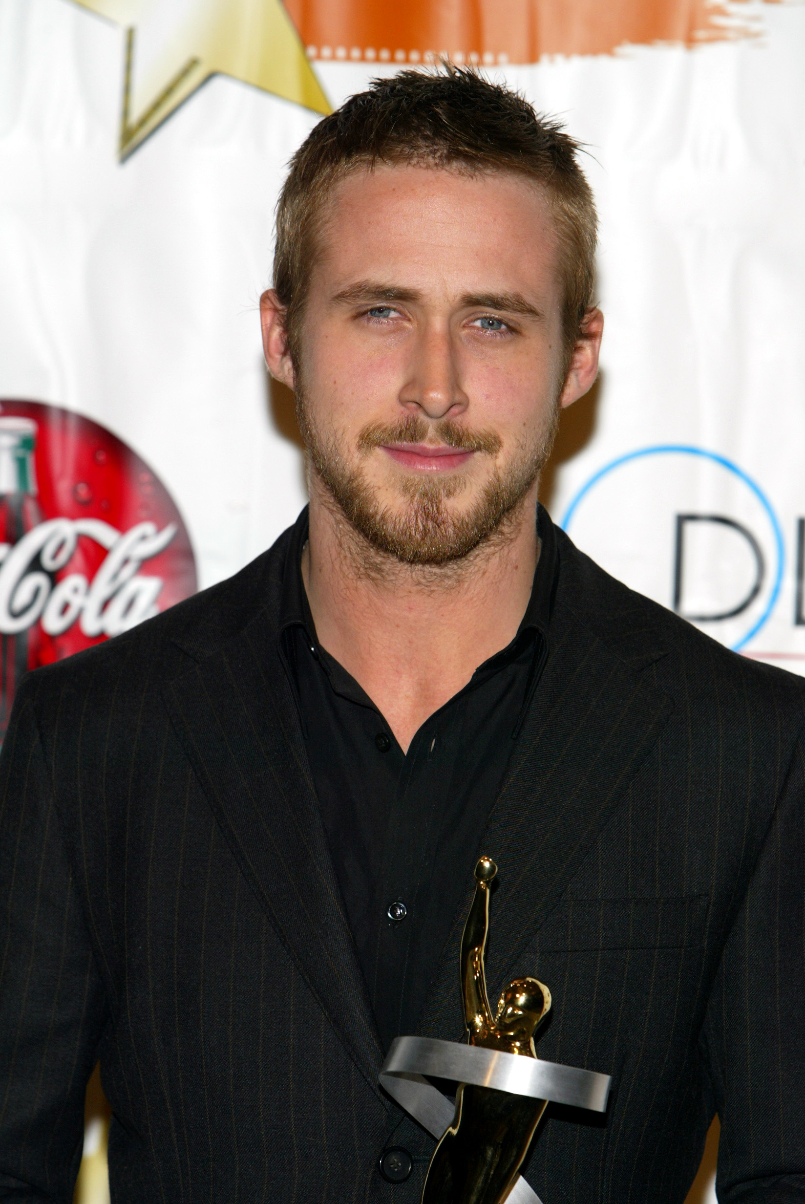"""Ryan Gosling holds his """"Male Star of Tomorrow"""" award at the ShoWest 2004 Gala Awards Banquet held at the Paris Las Vegas Hotel Casino."""