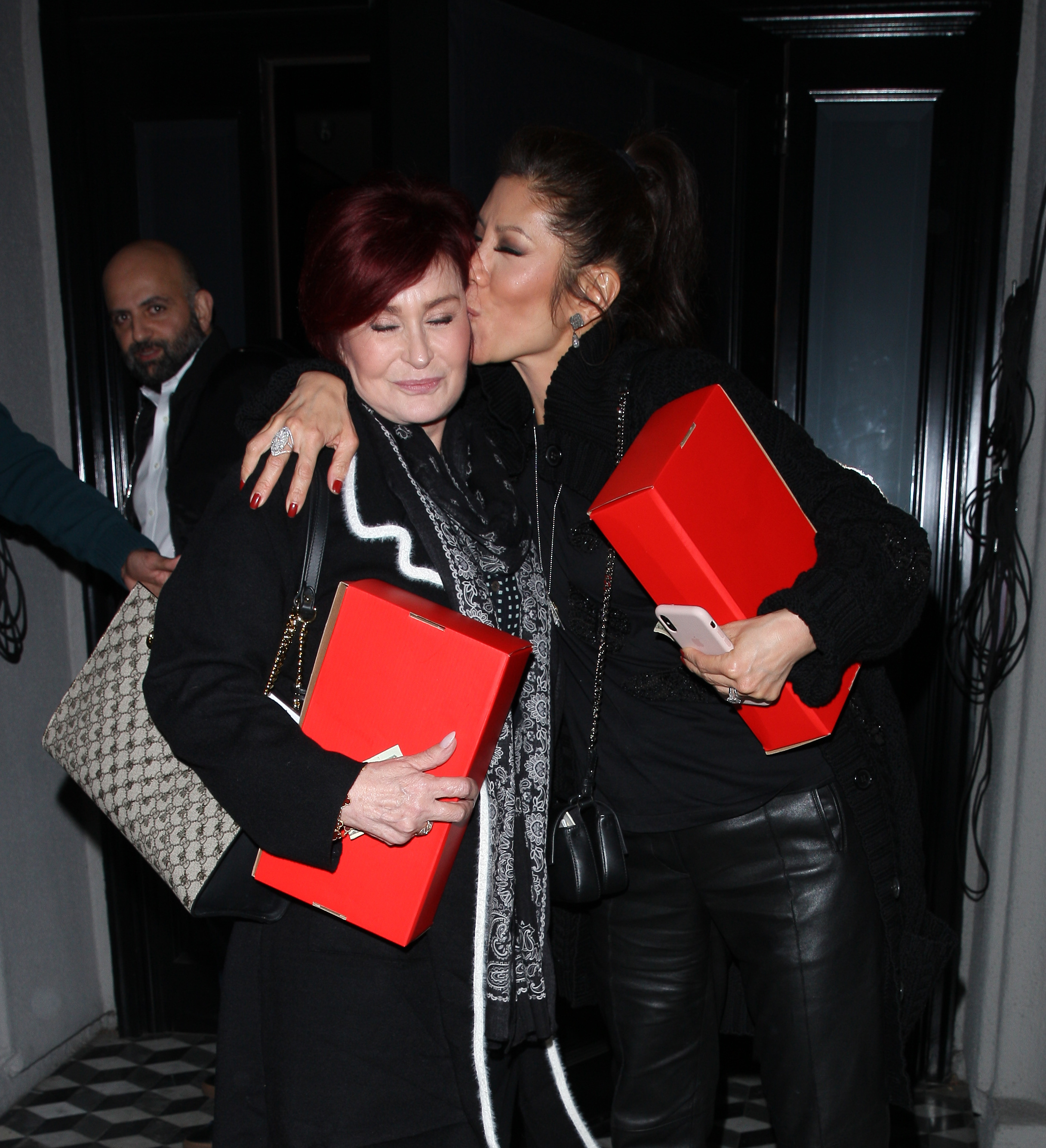 Sharon Osbourne gets a kiss on the cheek from Julie Chen as they dine at Craig's restaurant together in West Hollywood, CA on Jan. 30, 2018.