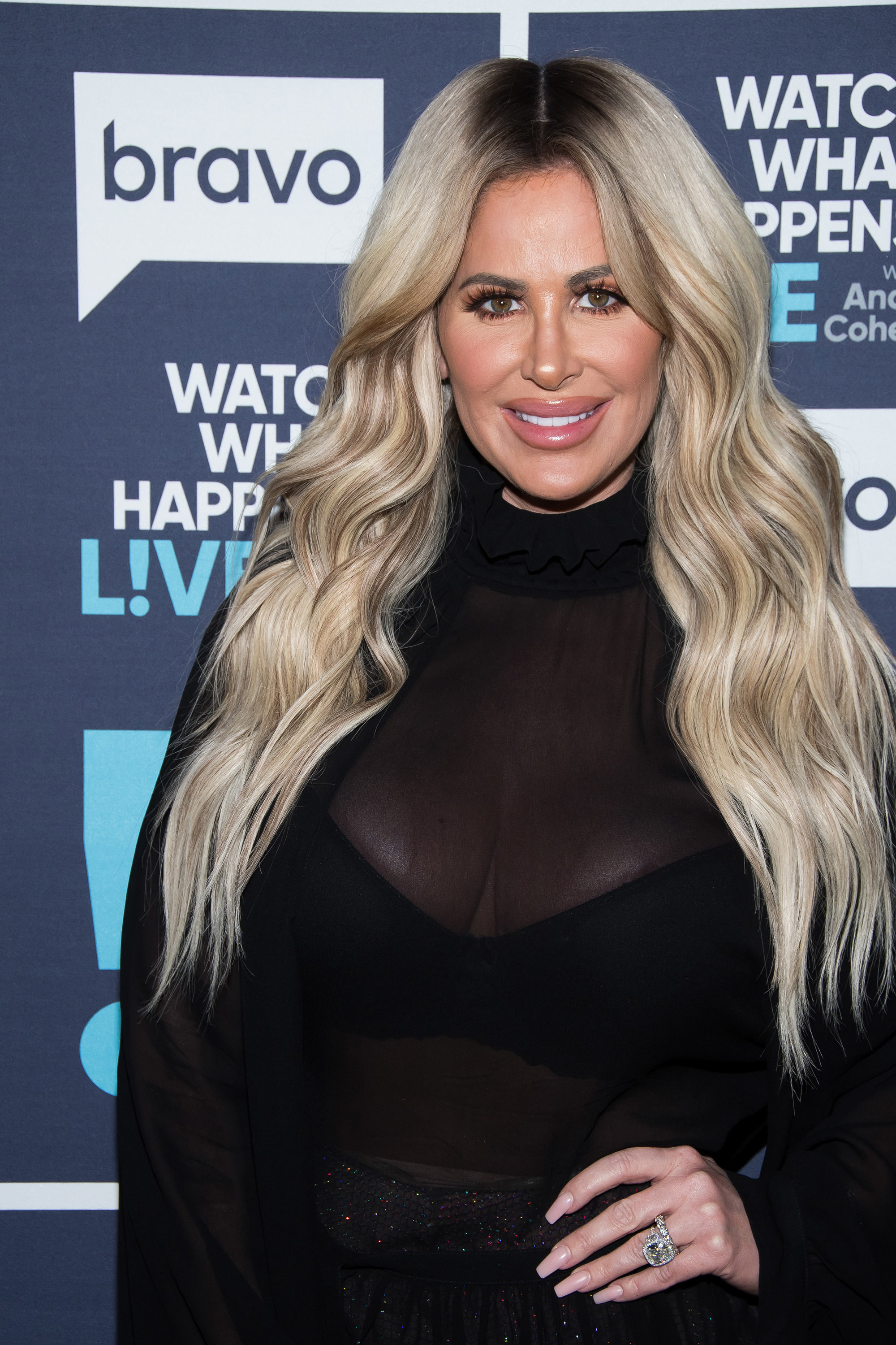 """Kim Zolciak Biermann poses outside the """"Watch What Happens Live With Andy Cohen"""" studio in New York City on Dec. 17, 2017."""
