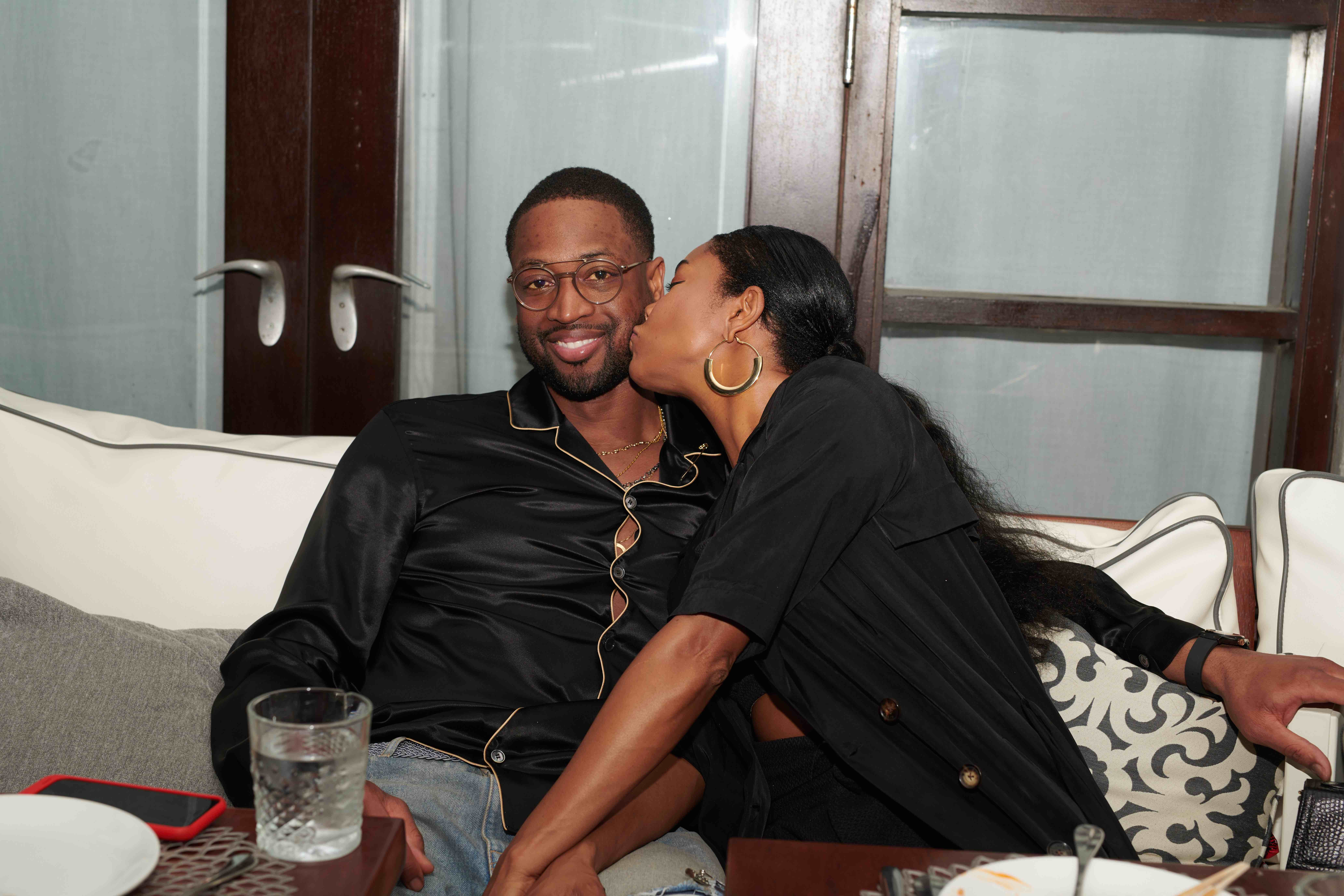 Gabrielle Union pecks husband Dwyane Wade on the cheek during a night out at Leynia restaurant at the Delano hotel in Miami on Feb. 9, 2018.