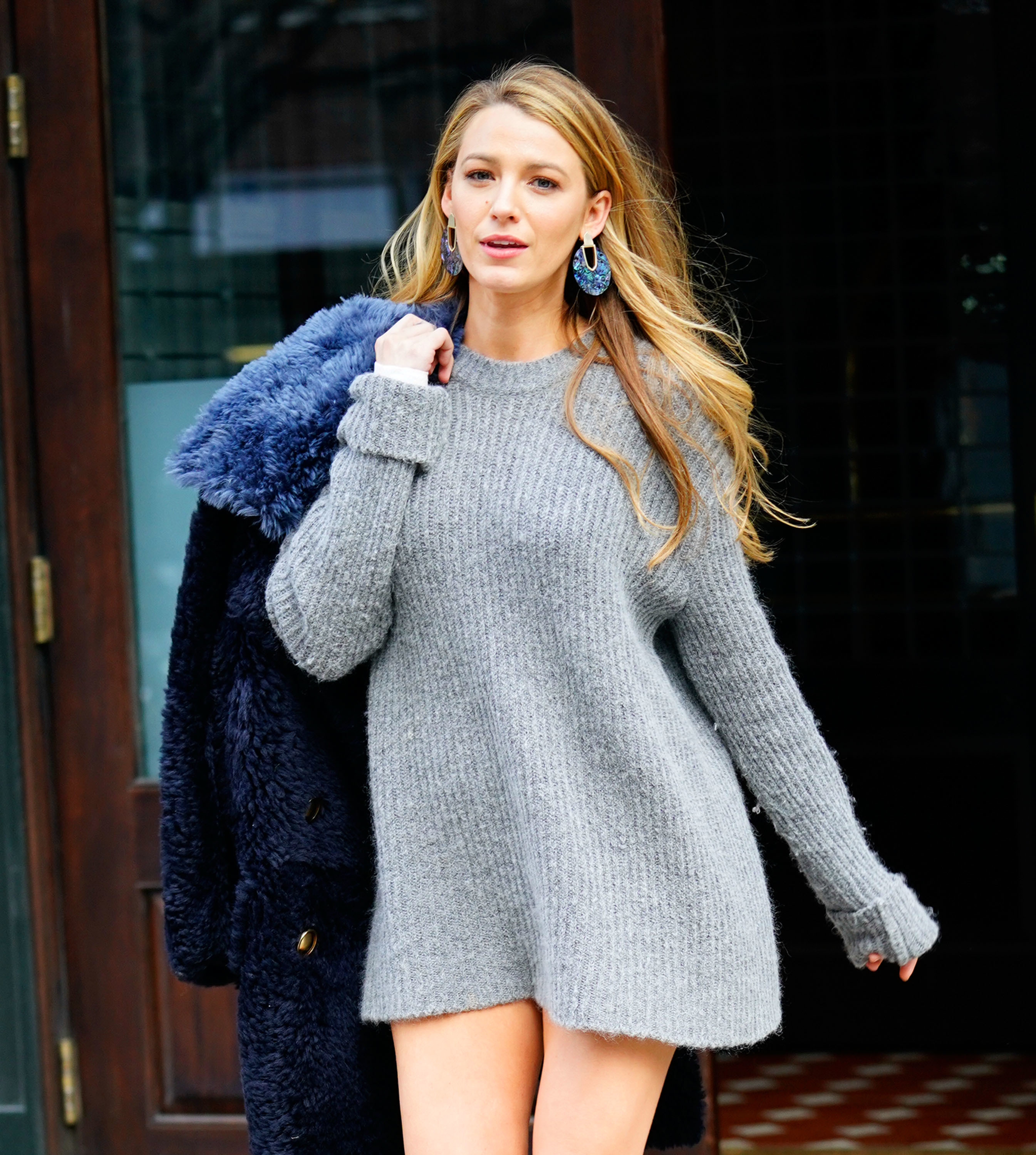 Blake Lively is spotted out and about in a cute grey outfit with knee high boots and blue furry coat in New York City on Feb. 15, 2018.