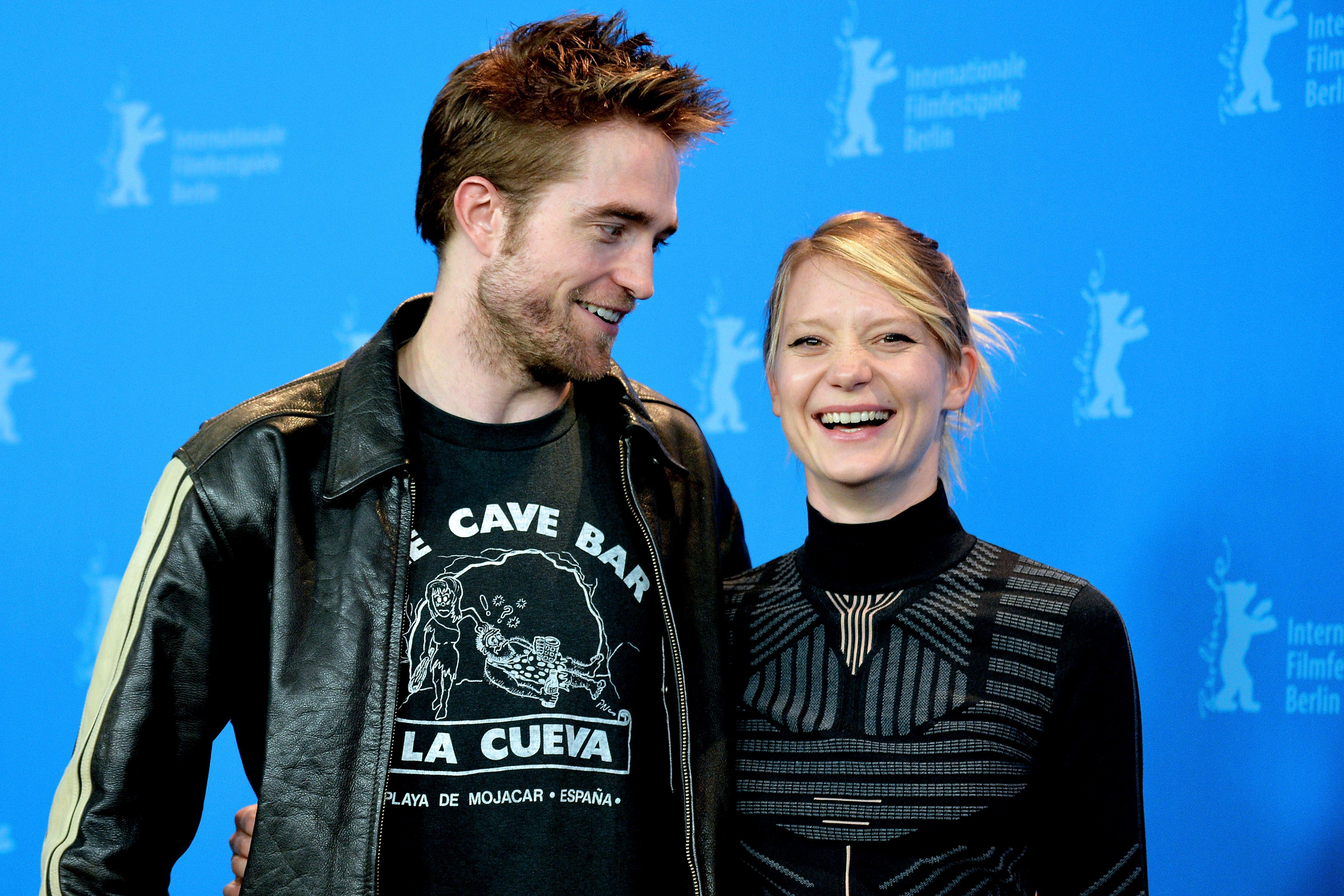 """Robert Pattinson and Mia Wasikowska attend the """"Damsel"""" photocall at the 68th Berlin Film Festival on Feb. 16, 2018."""