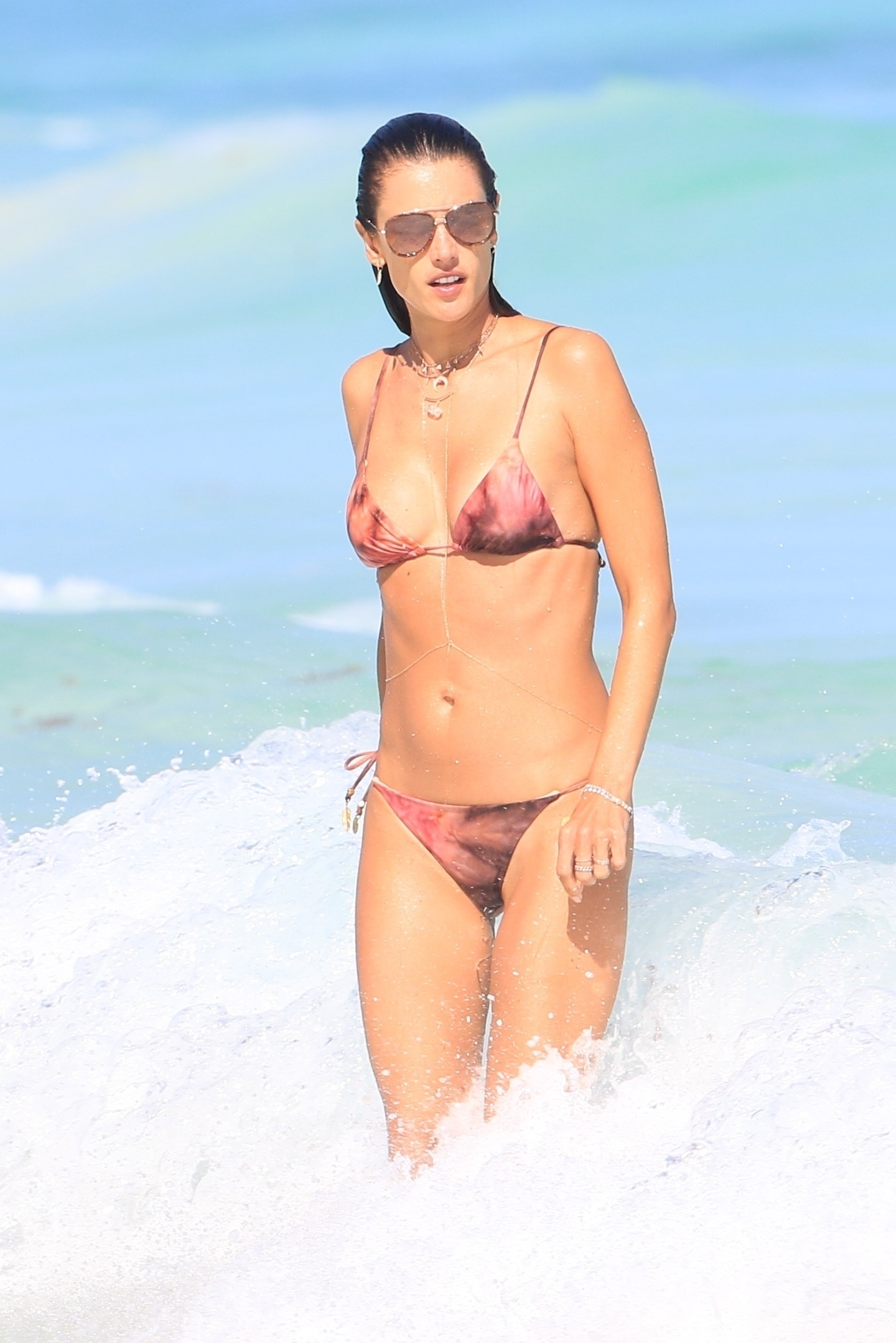 Alessandra Ambrosio was all smiles as she showed off her svelte figure on the beach in Cancun, Mexico, on Feb. 18, 2018.