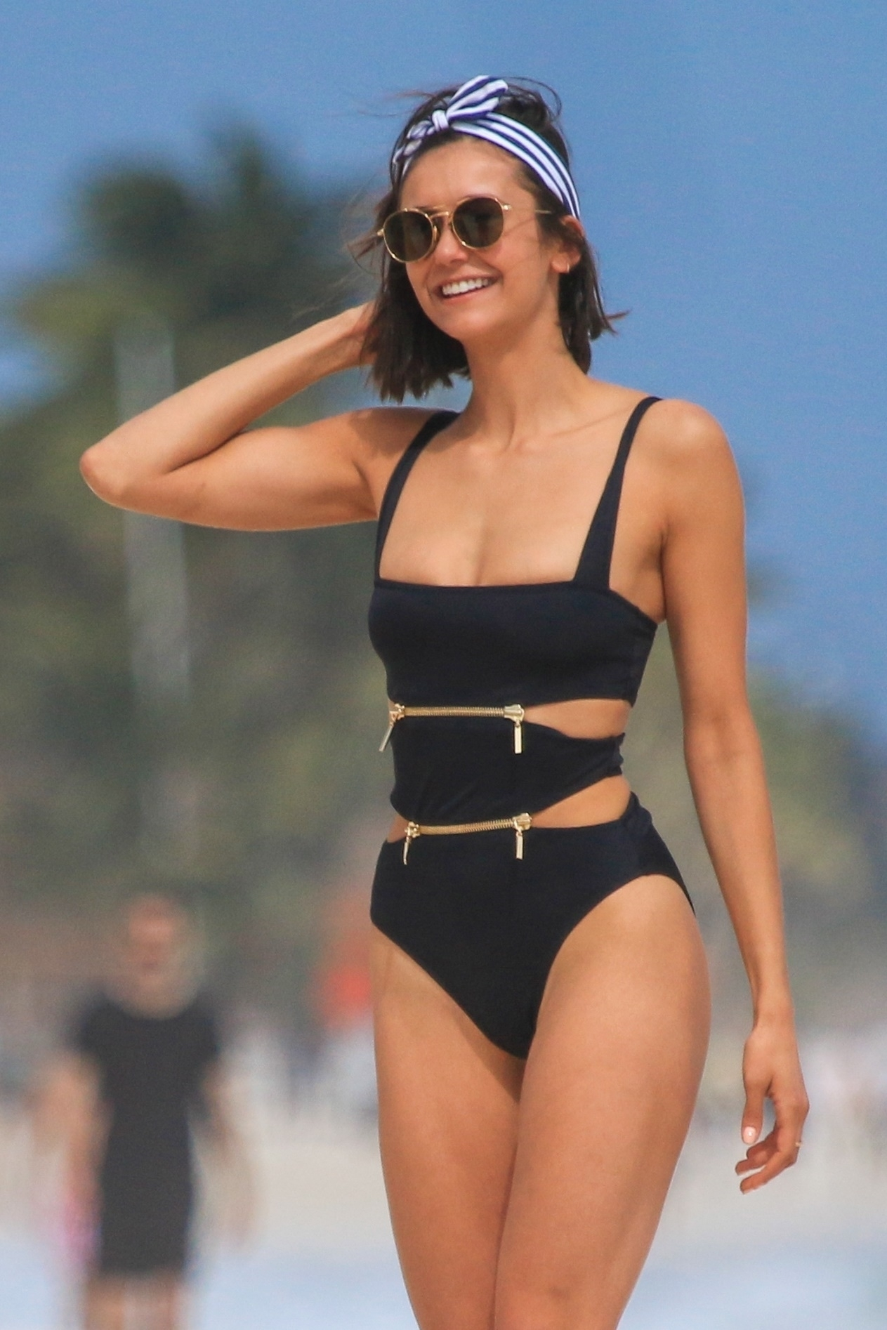 Nina Dobrev shows off her flawless physique in revealing ensembles as she enjoyed the day at the beach in Tulum on Jan. 20, 2018.