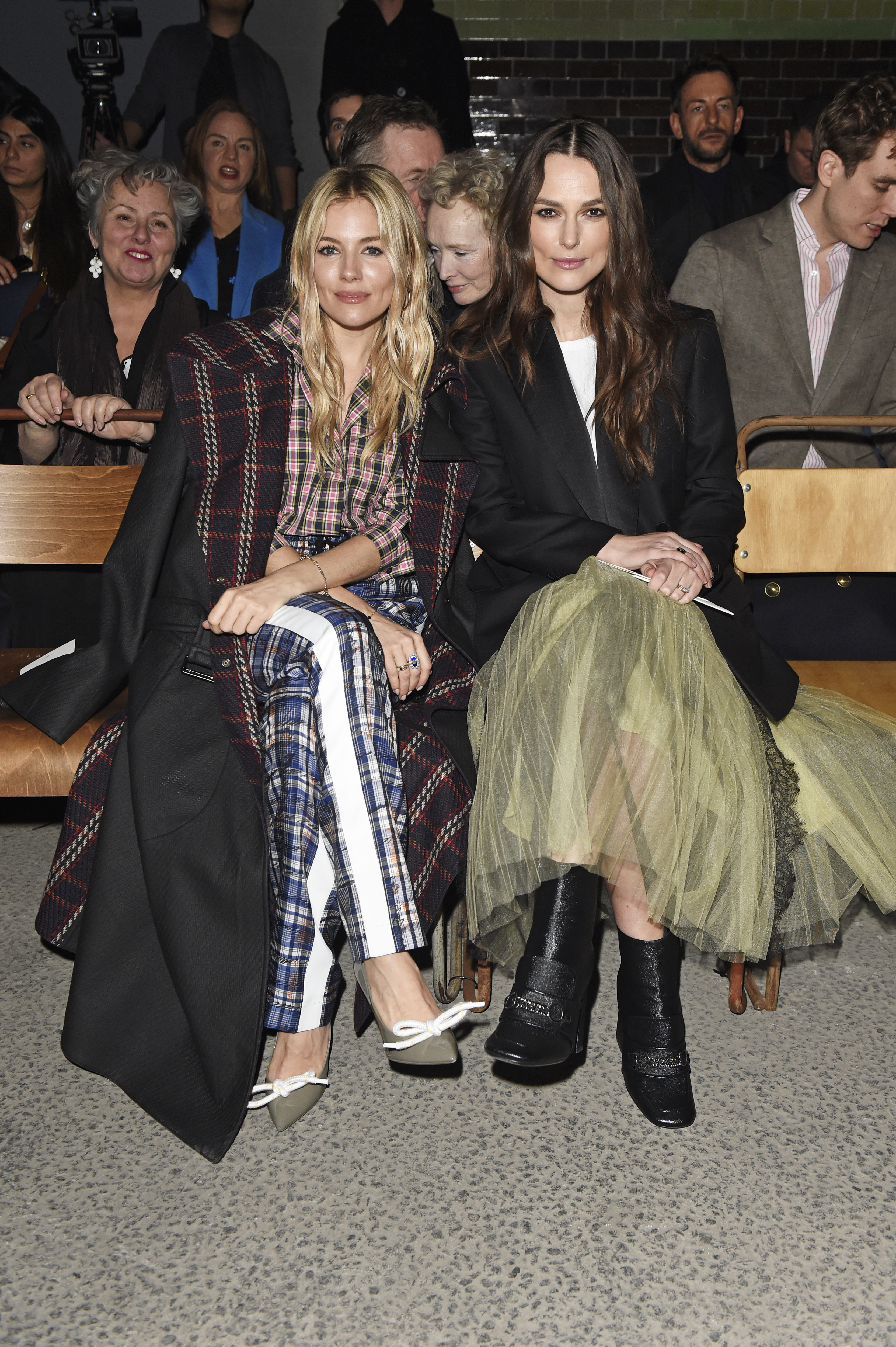 Sienna Miller and Keira Knightley attend the Burberry February 2018 show during London Fashion Week at Dimco Buildings in London on Feb. 17, 2018.