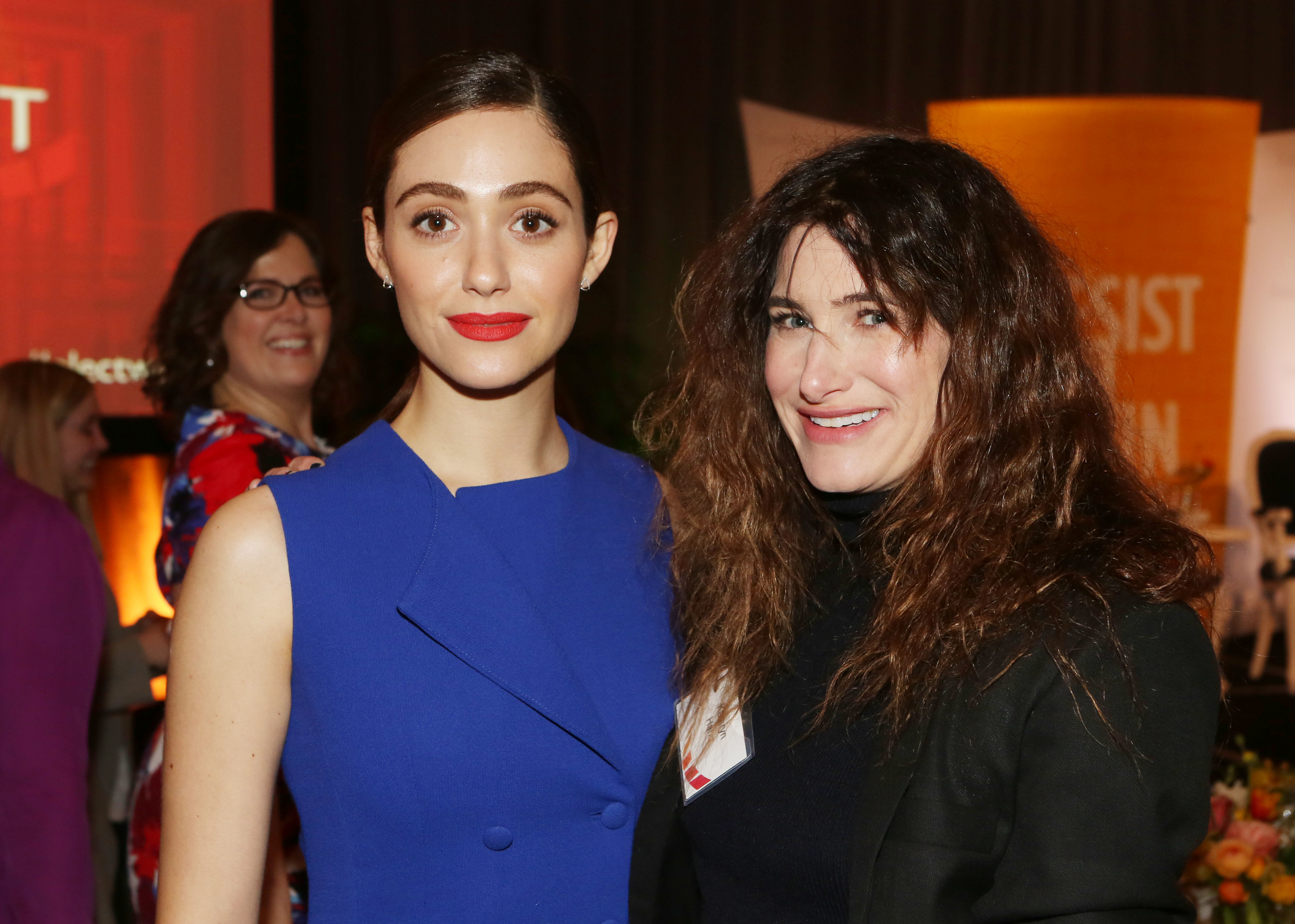 Emmy Rossum and Kathryn Hahn attend the Emily's List Run. Resist. Win event in Los Angeles on Feb. 27, 2018.