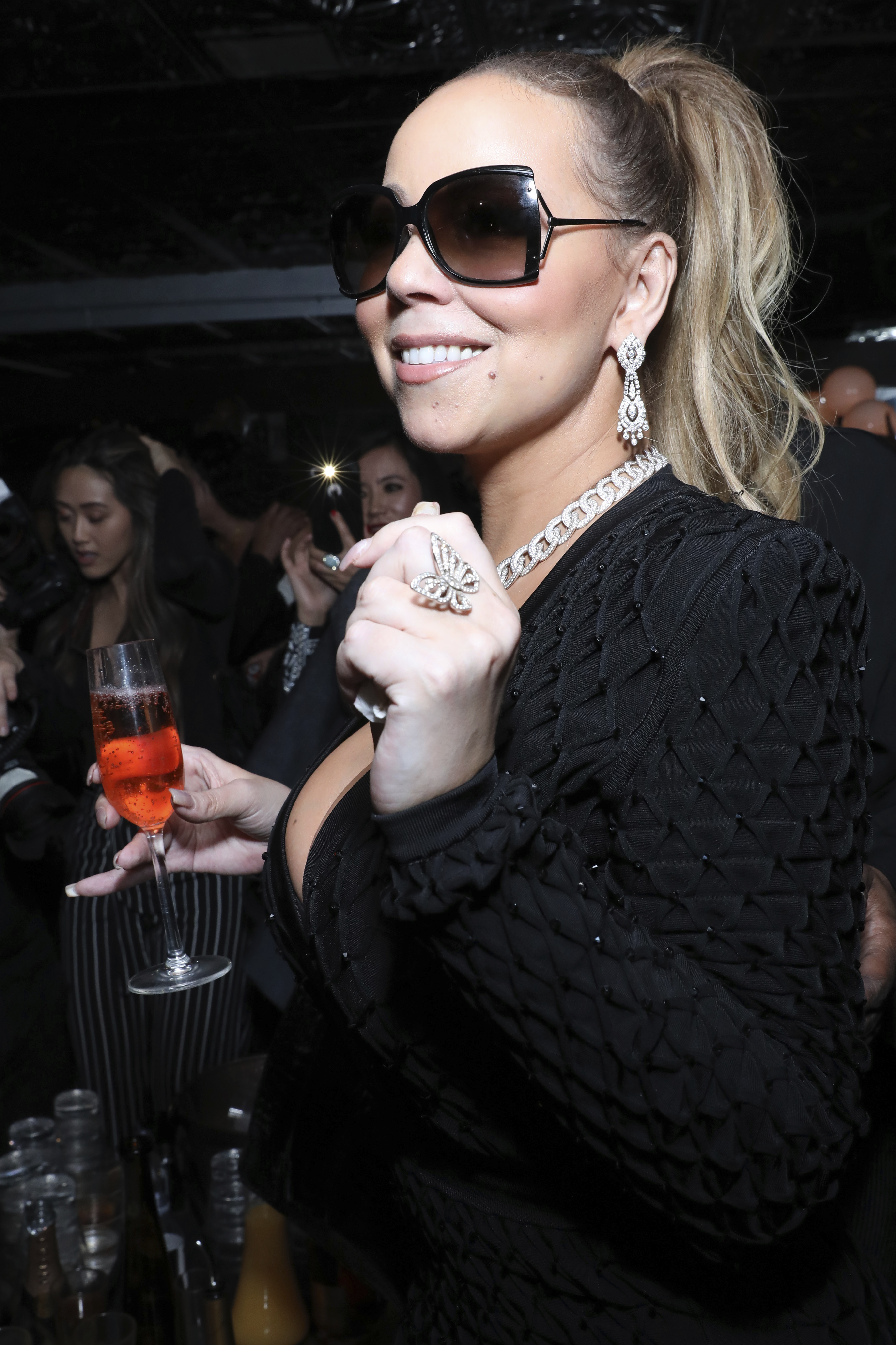 Mariah Carey poses for a photo at Floyd Mayweather's 41st Birthday Party in Los Angeles on Feb. 24, 2018.