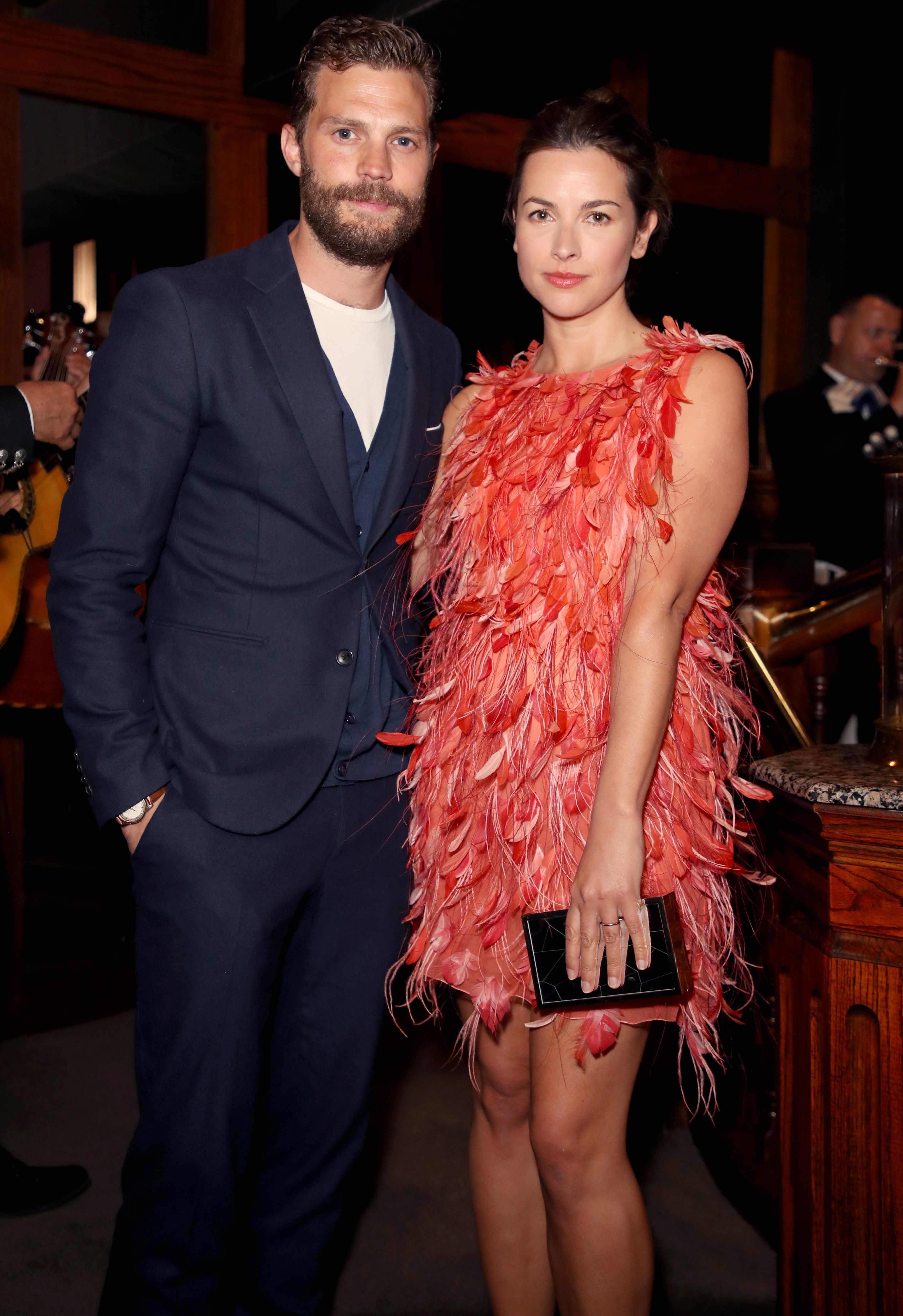 Jamie Dornan and Amelia Warner attend the Chanel and Charles Finch Pre Oscar dinner in Los Angeles on March 3, 2018.