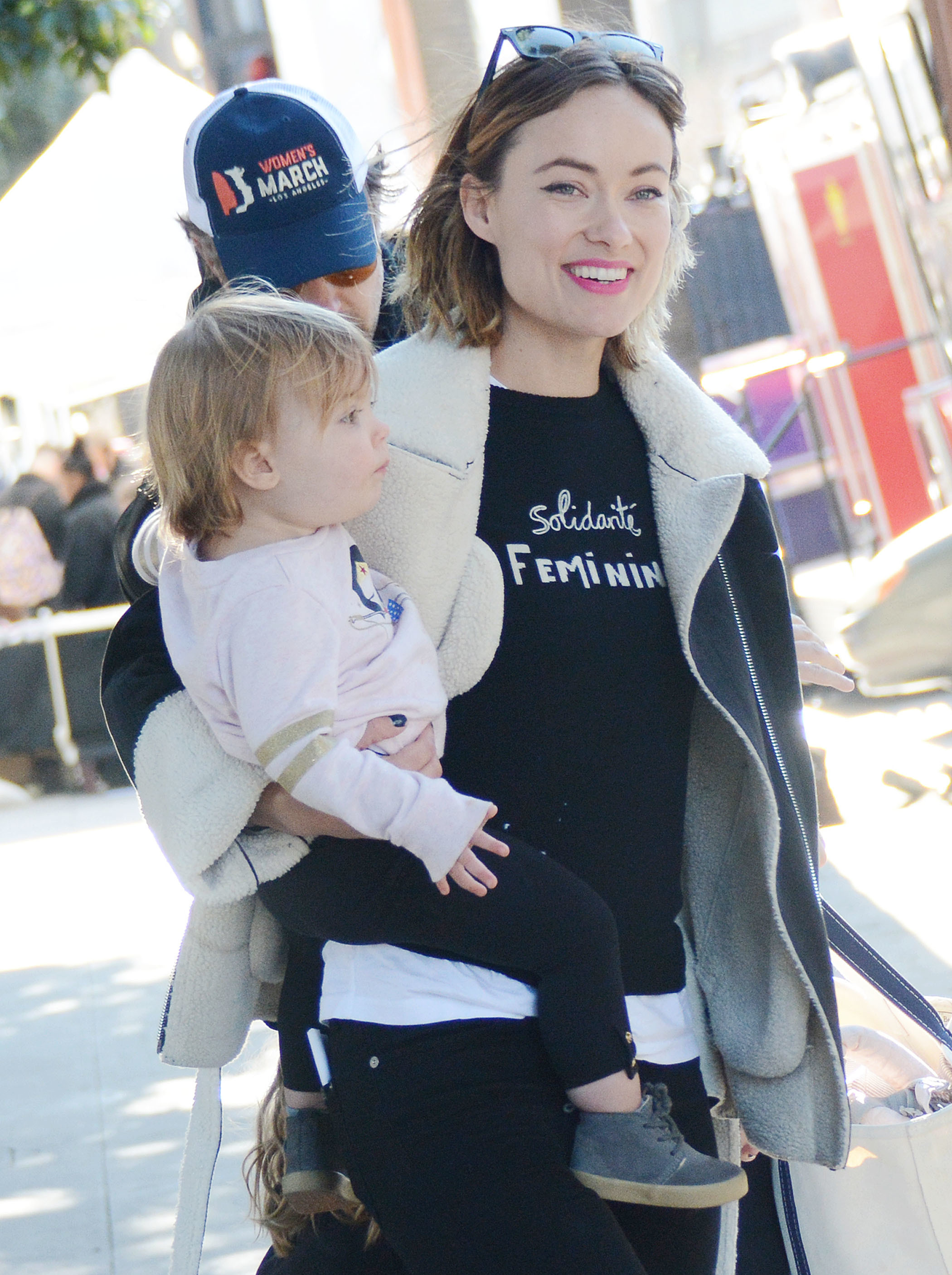 Olivia Wilde and her family attend the Women's March rally in Los Angeles on Jan. 20, 2018.