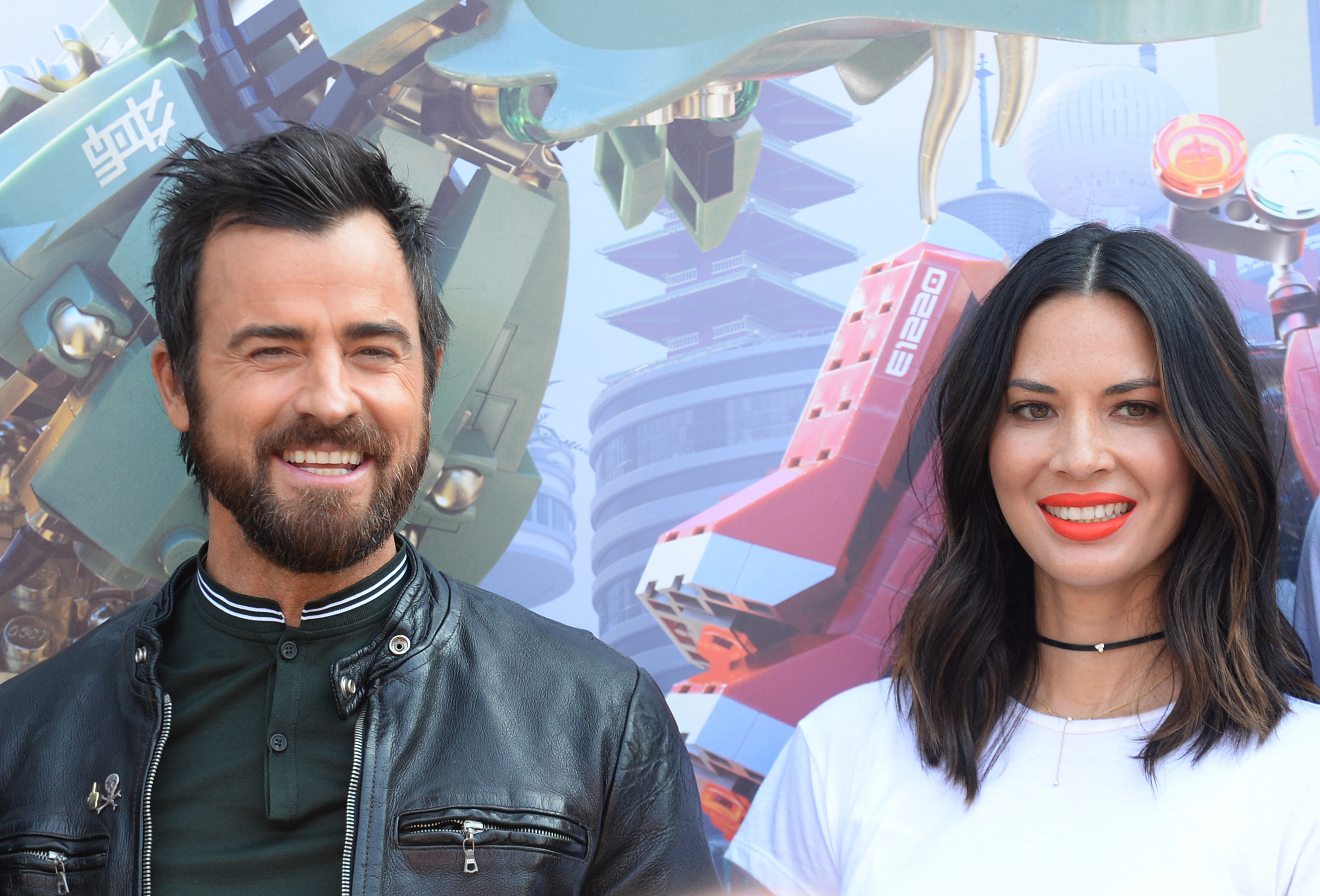 """Justin Theroux and Olivia Munn attend a photo call for """"The LEGO Ninjago Movie"""" at Comic Con in San Diego on July 21, 2017."""