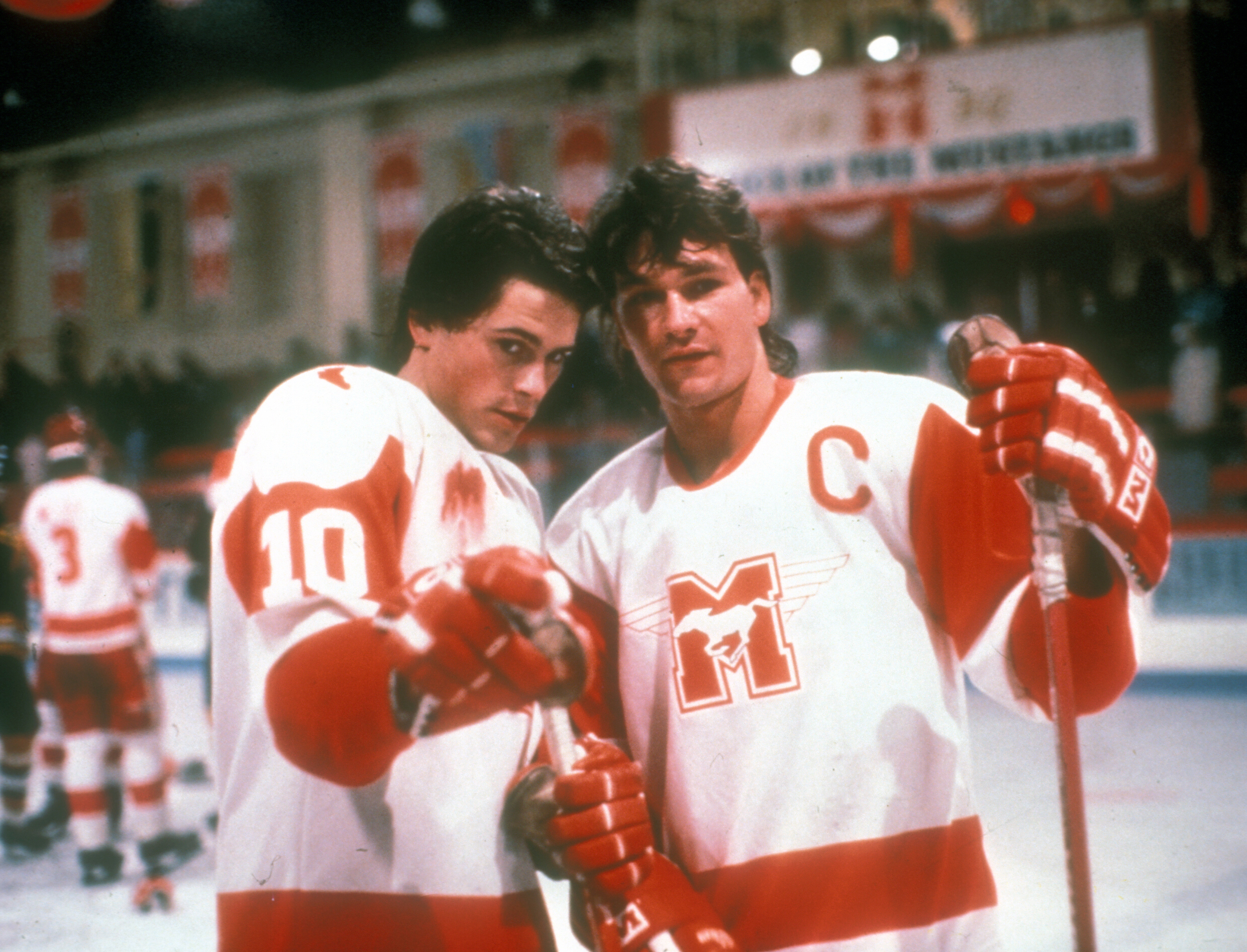 """Rob Lowe (as Dean Youngblood) and Patrick Swayze (as Derek Sutton) are shown on the set of """"Youngblood"""" in 1986."""