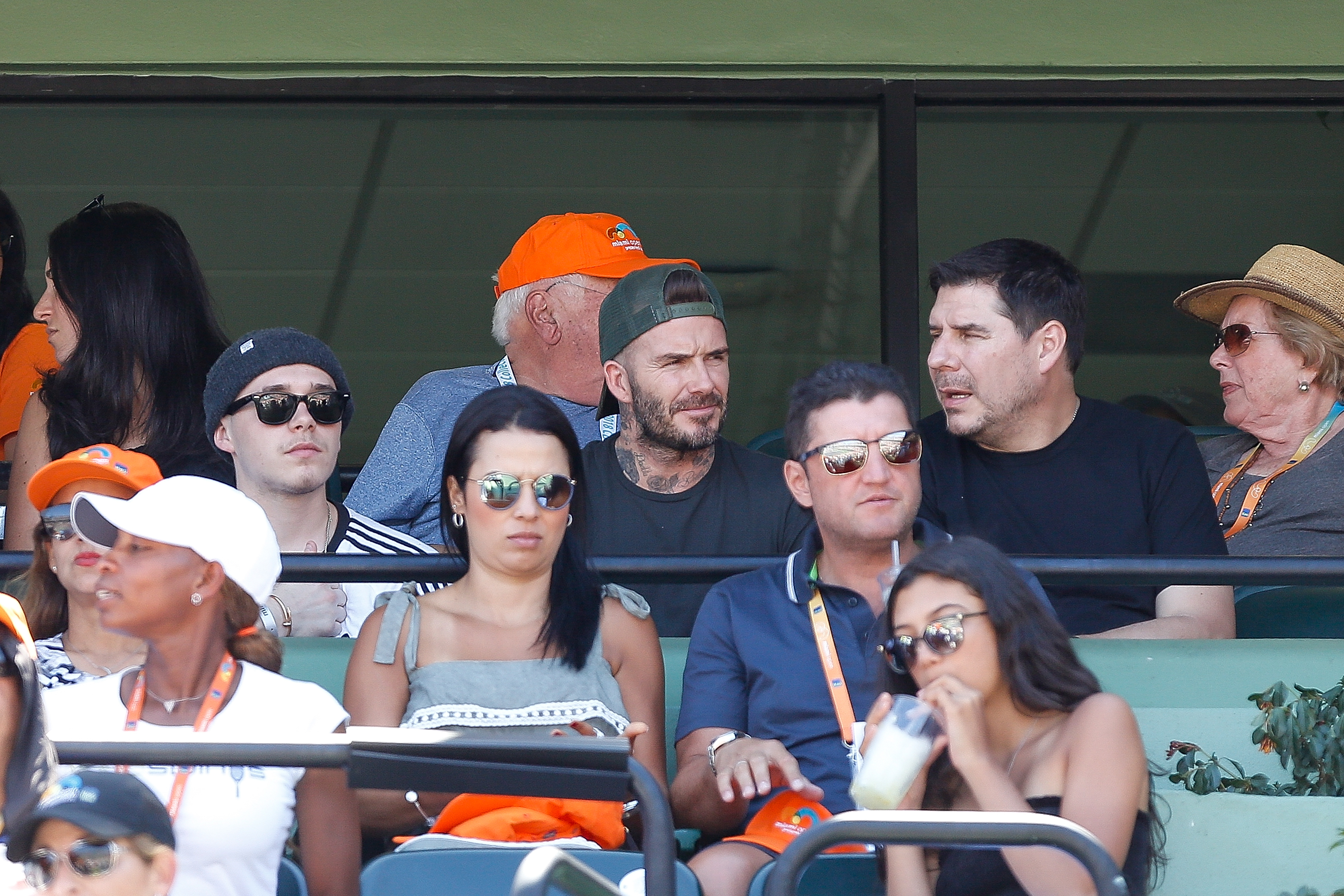 Brooklyn Beckham, David Beckham and Marcelo Claure, CEO of Sprint, watch the Miami Open men's final between John Isner of the United States and Alexander Zverev of Germany on Day 14 at Crandon Park Tennis Center in Key Biscayne, Florida, on April 1, 2018.