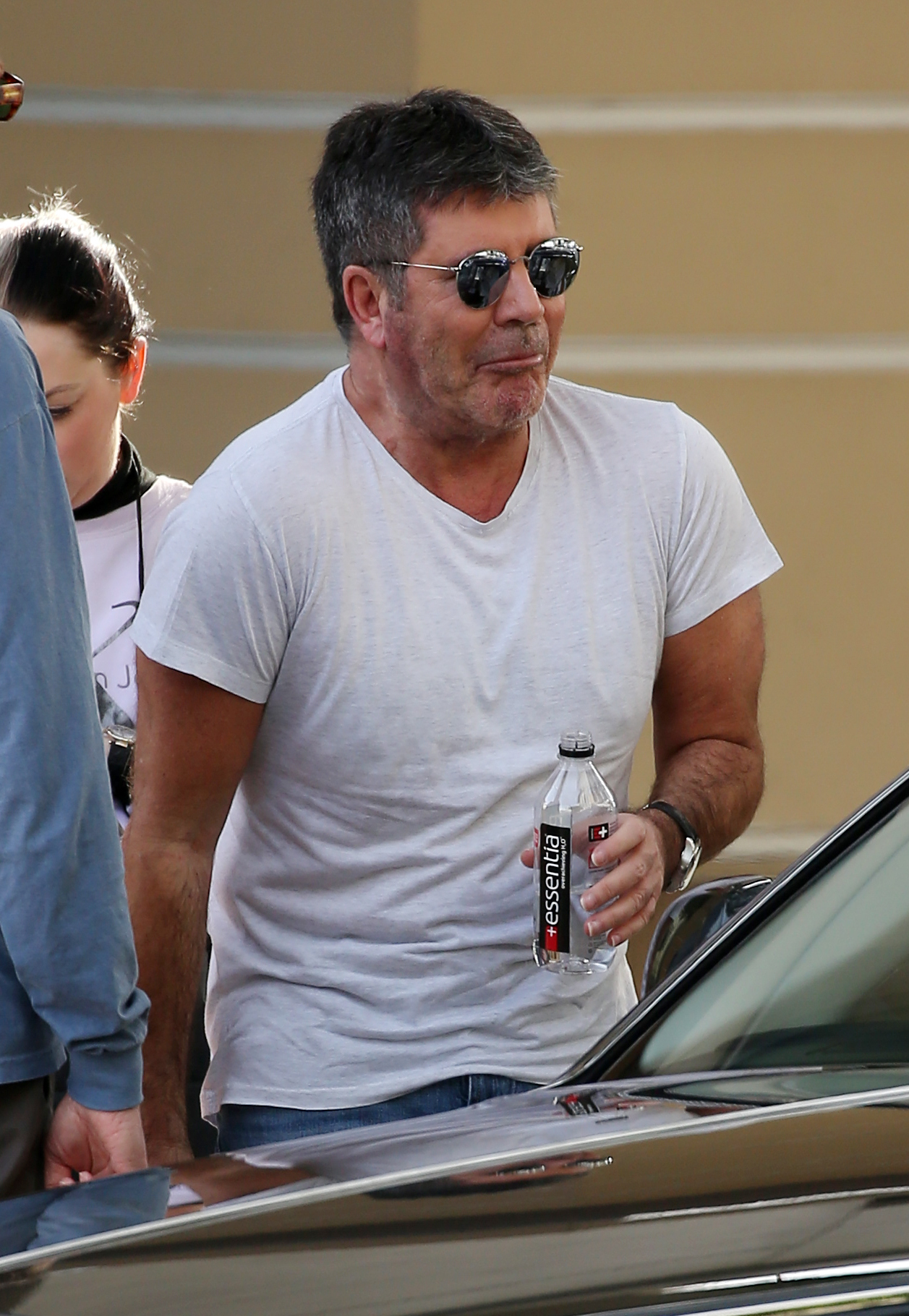"""Simon Cowell pulls a funny face as he drinks out of a bottle of water as he arrives at the """"America's Got Talent"""" filming in Pasadena, Calif., on March 18, 2018."""