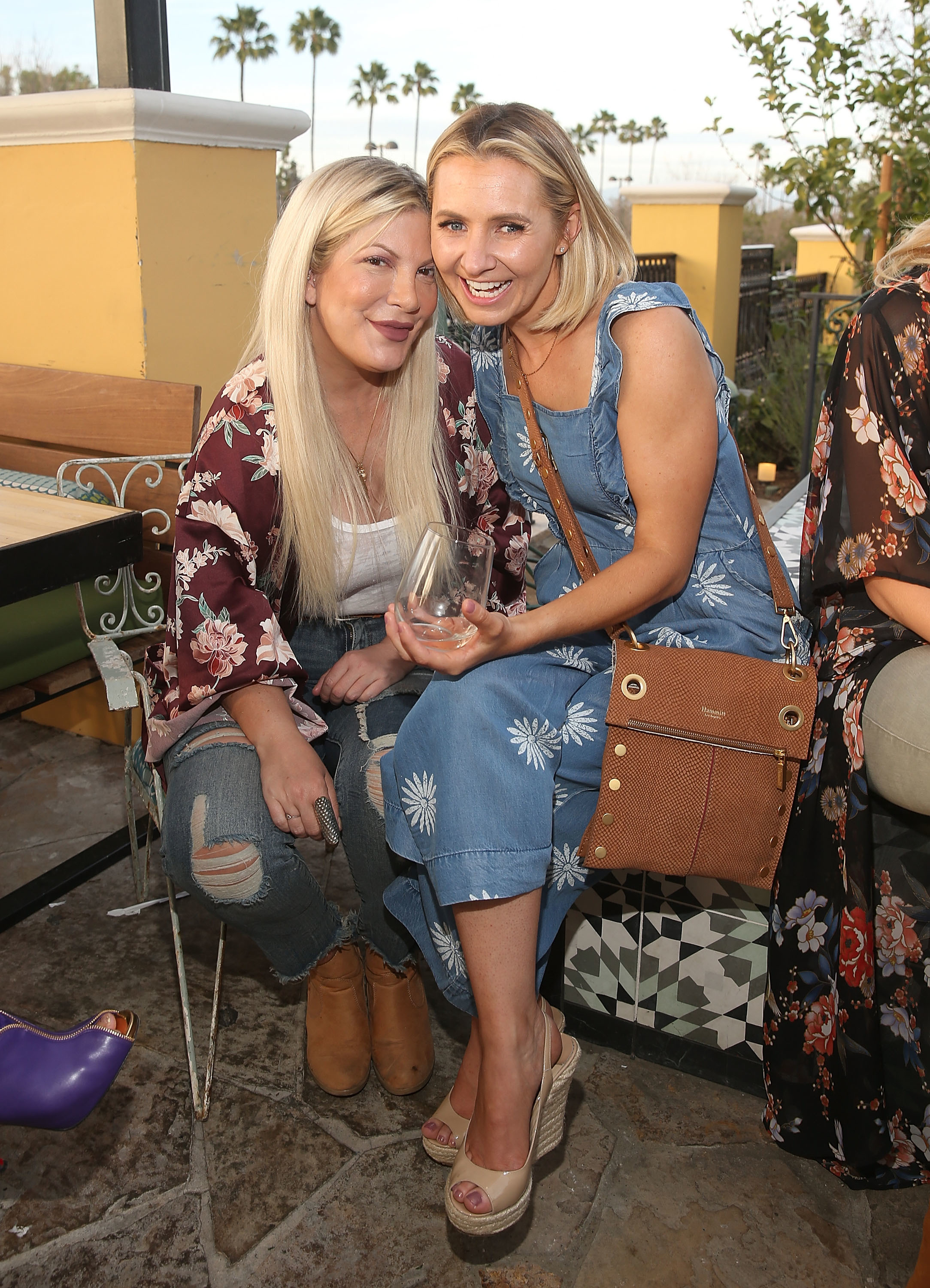 Tori Spelling and Beverley Mitchell attend The Millennial Mamas' Mom's Night Out at The Commons at Calabasas in Calabasas, California, on April 10, 2018.