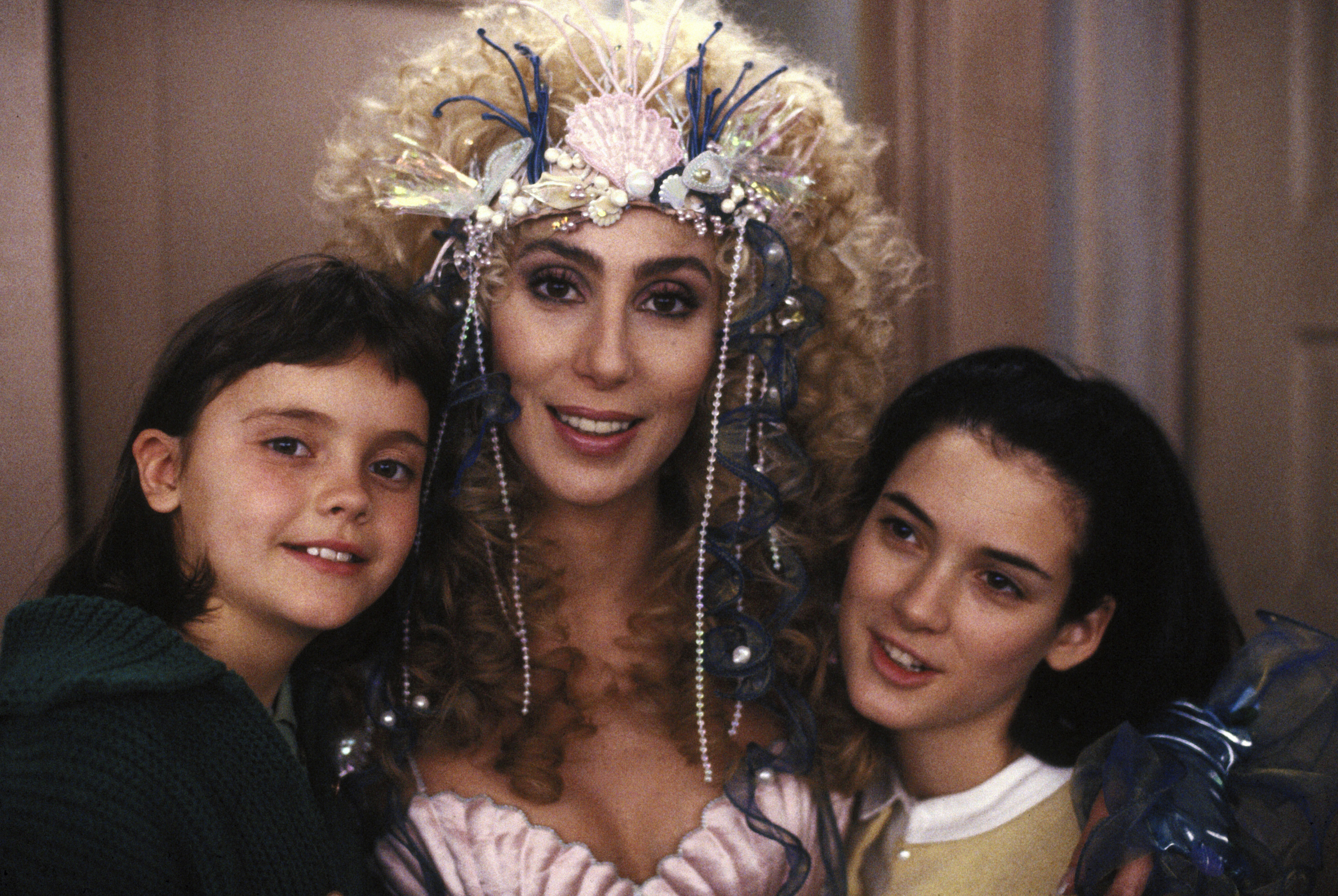 "Christina Ricci, Cher and Winona Ryder are pictured on the set of ""Mermaids"" in 1990."