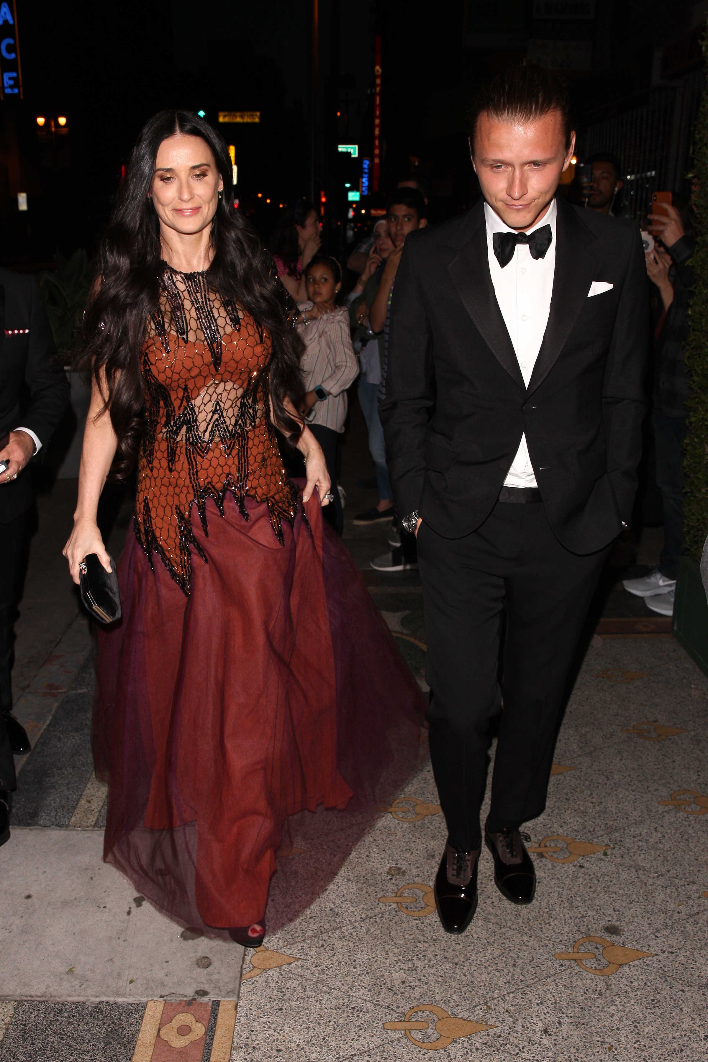 Demi Moore and her boyfriend arrive at Gwyneth Paltrow and Brad Falchuk's engagement party at the Los Angeles Theater in downtown L.A. on April 14, 2018.