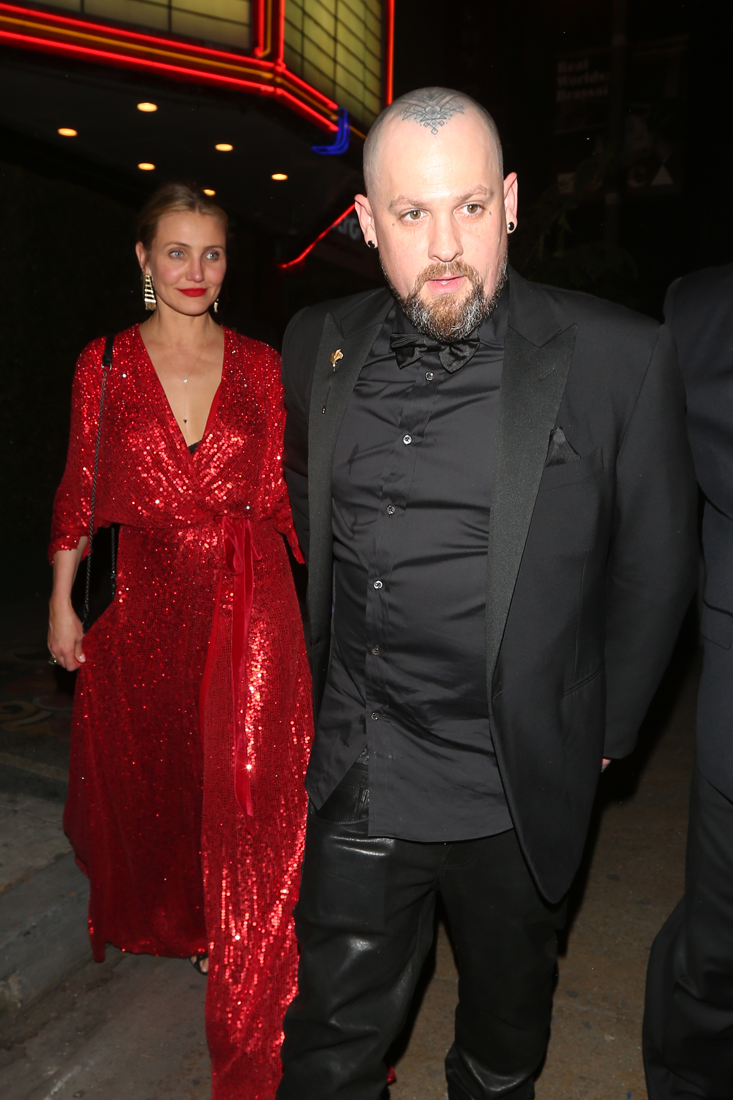 Cameron Diaz and husband Benji Madden arrive at Gwyneth Paltrow and Brad Falchuk's engagement party at the Los Angeles Theater in downtown L.A. on April 14, 2018.