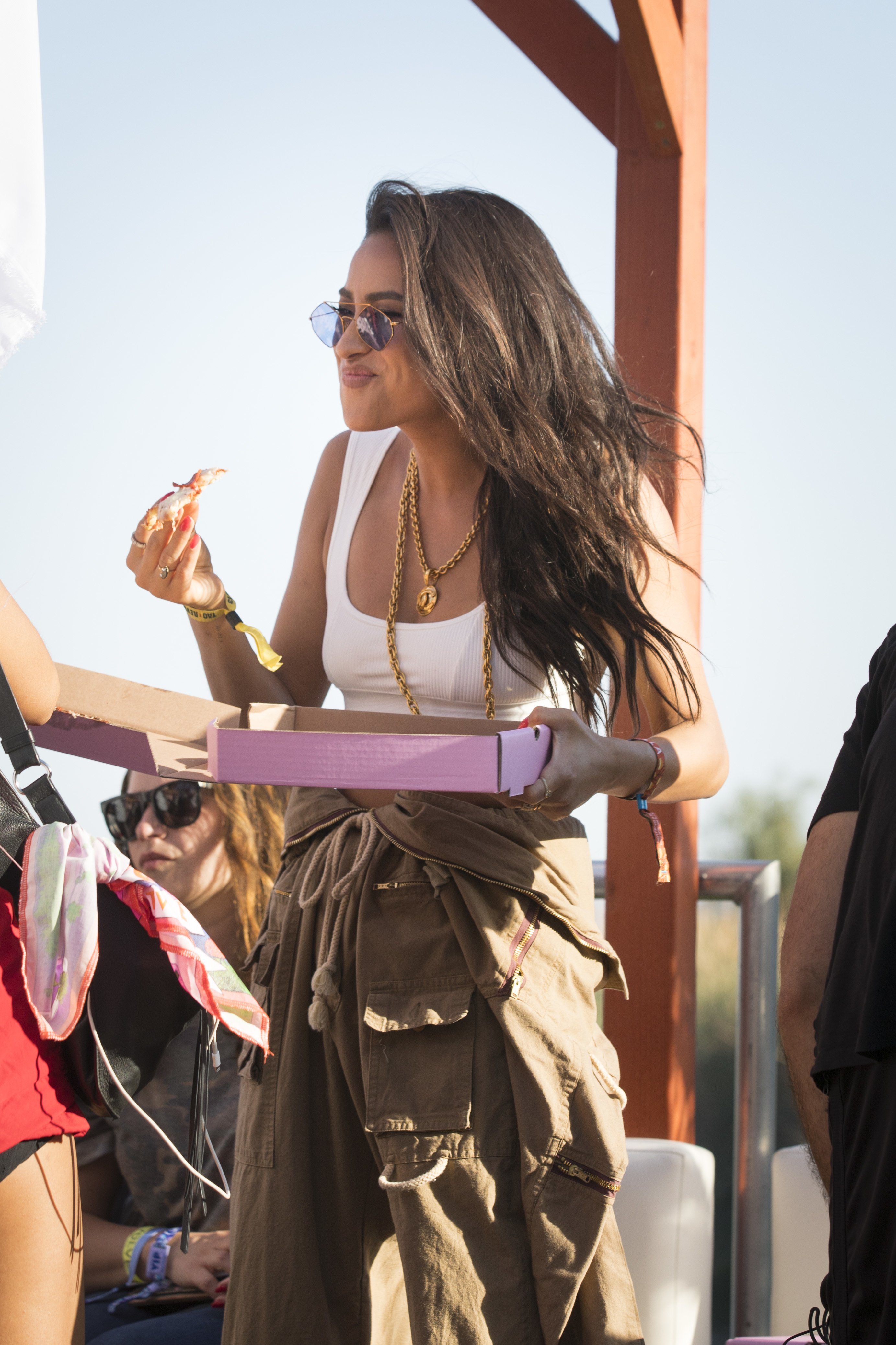 Shay Mitchell snacks on pizza delivered by Postmates during the #REVOLVEfestival in Indio, California, on April 14, 2018.