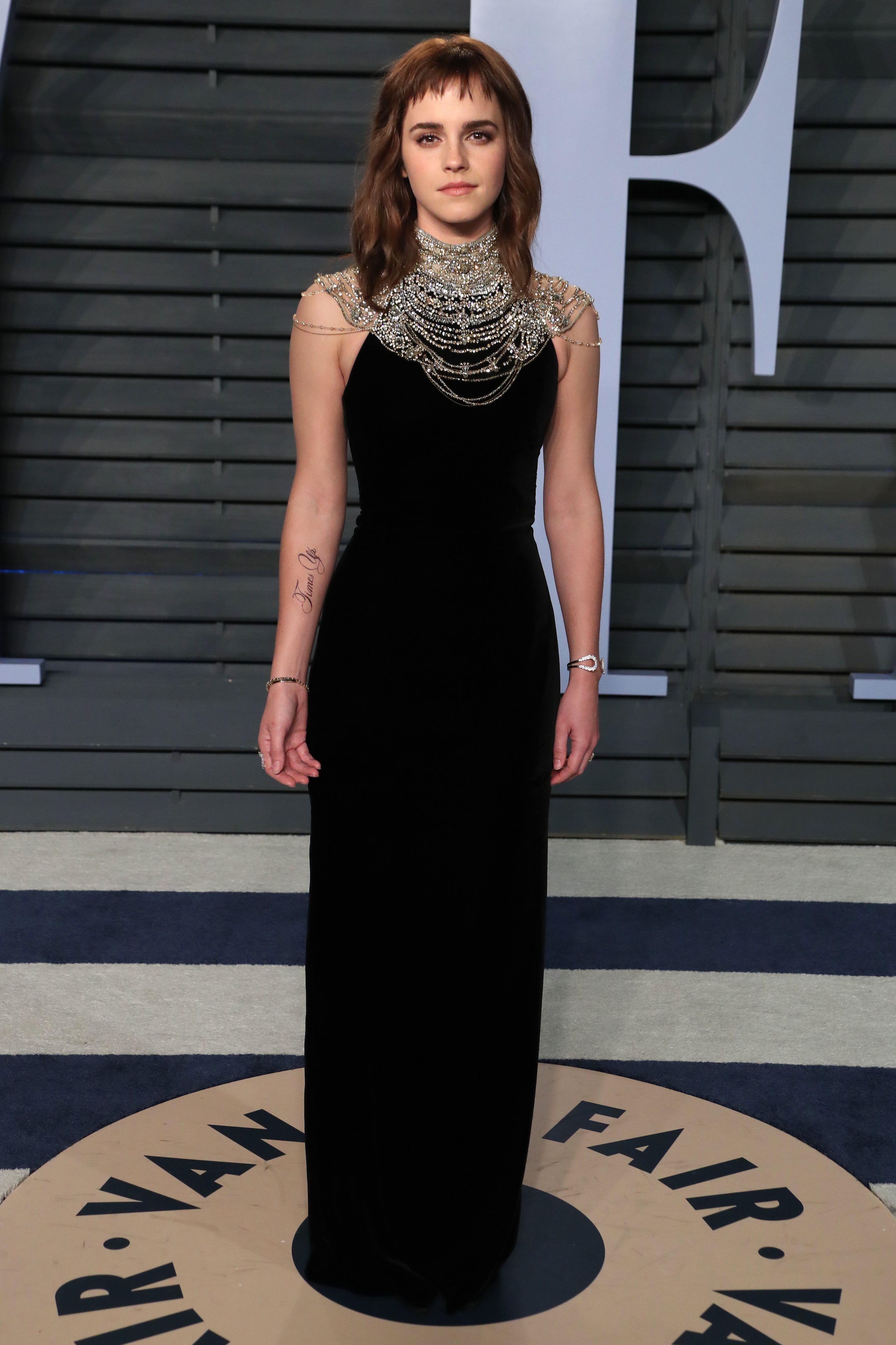 Emma Watson wears Ralph Lauren to the Vanity Fair Oscar Party in Beverly Hills on March 4, 2018.