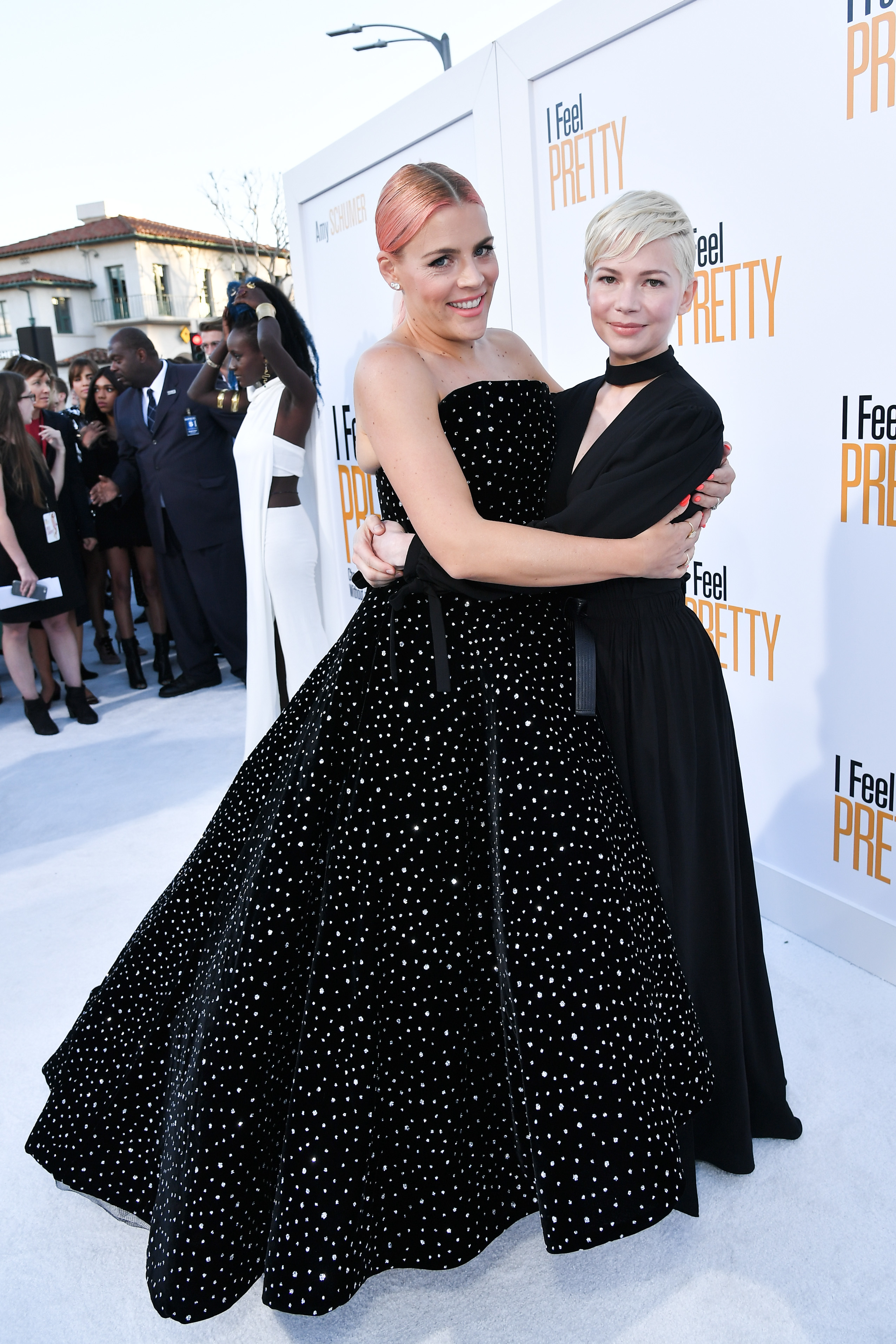 """Busy Philipps and Michelle Williams attend the """"I Feel Pretty"""" premiere in Los Angeles on April 17, 2018."""