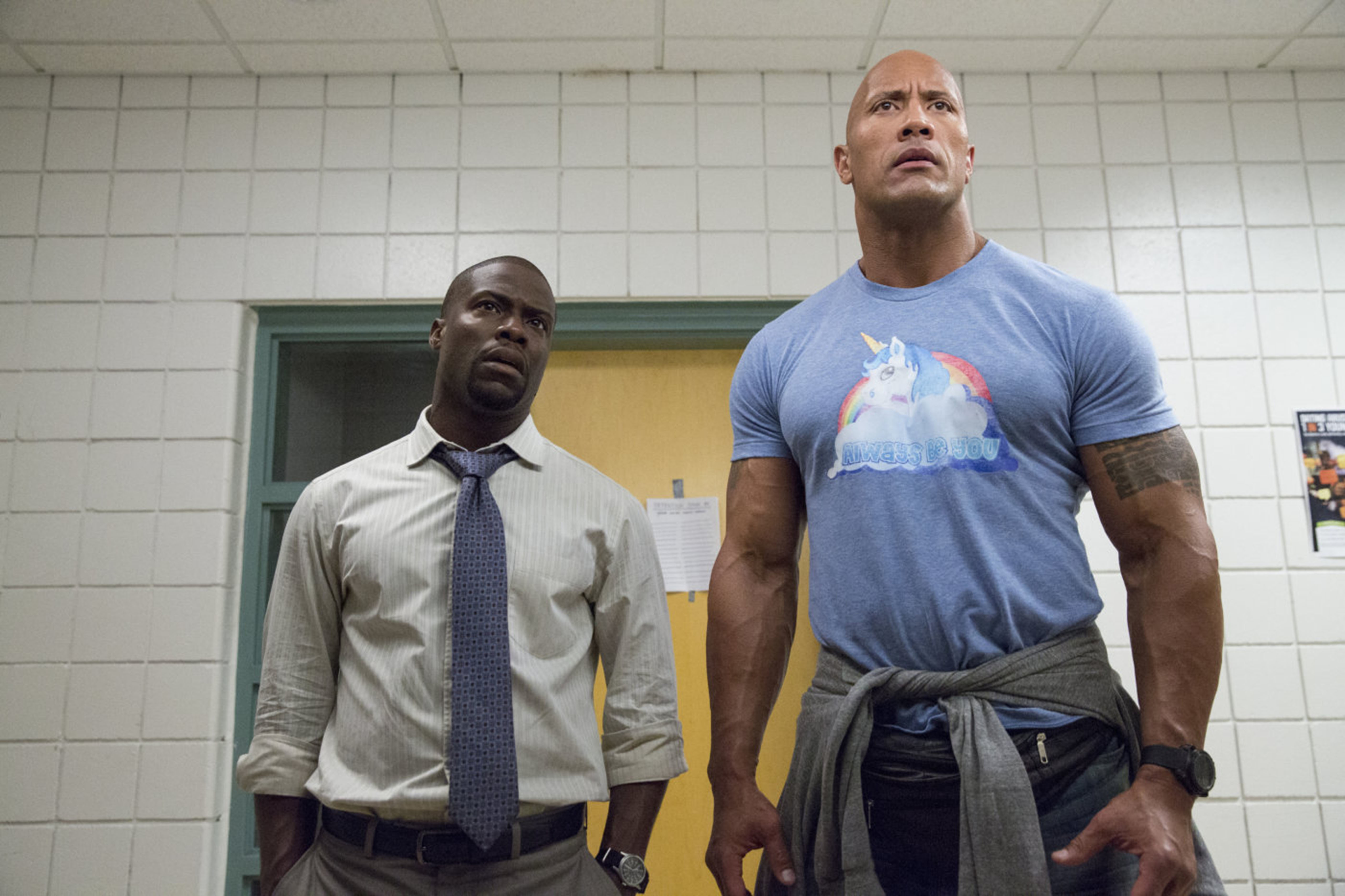 """Kevin Hart and Dwayne Johnson are pictured on the set of """"Central Intelligence"""" in 2016."""