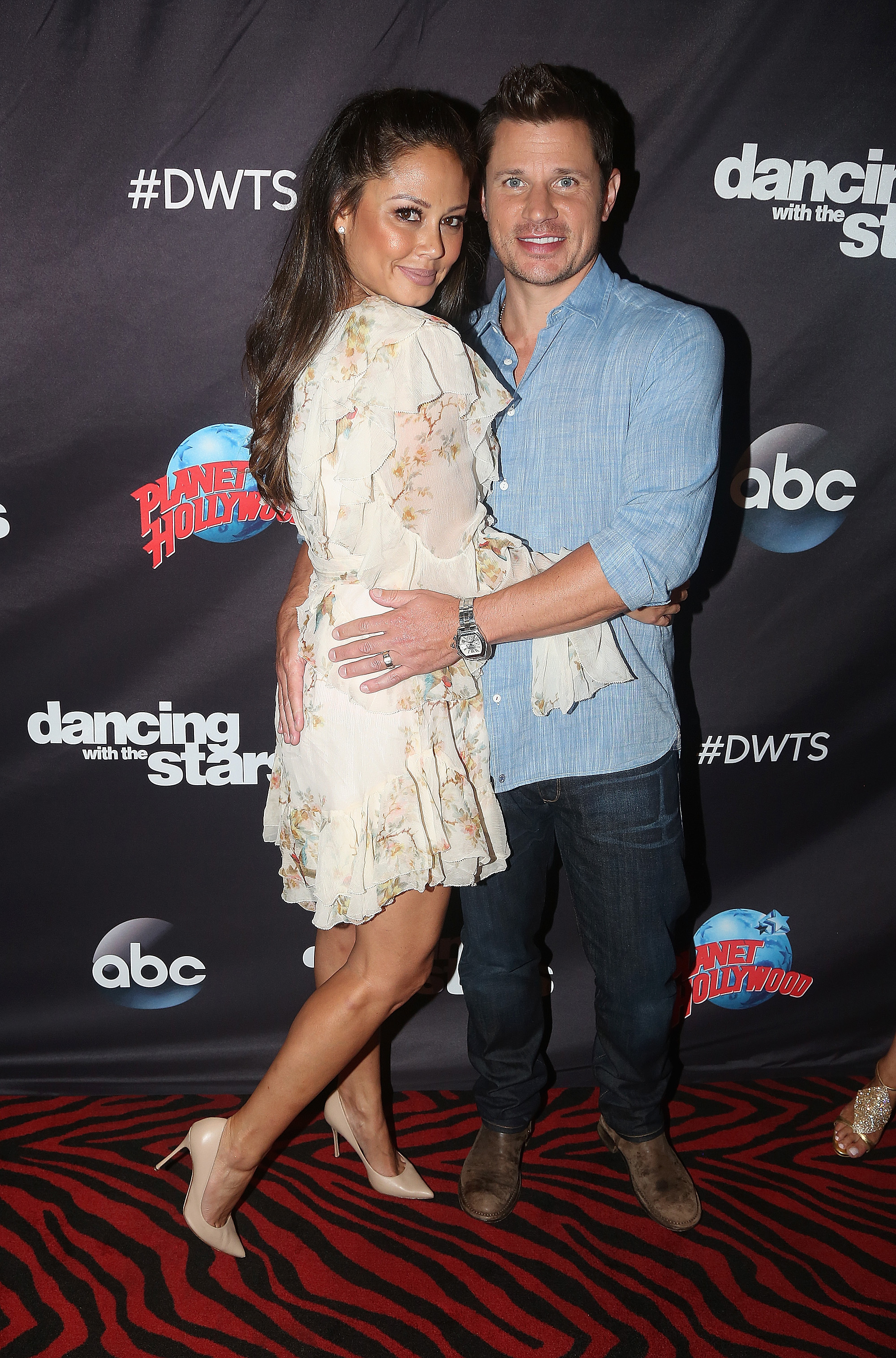 """Vanessa Lachey and Nick Lachey pose at ABC's """"Dancing with the Stars"""" Season 5 cast announcement event in New York City on Sept. 6, 2017."""