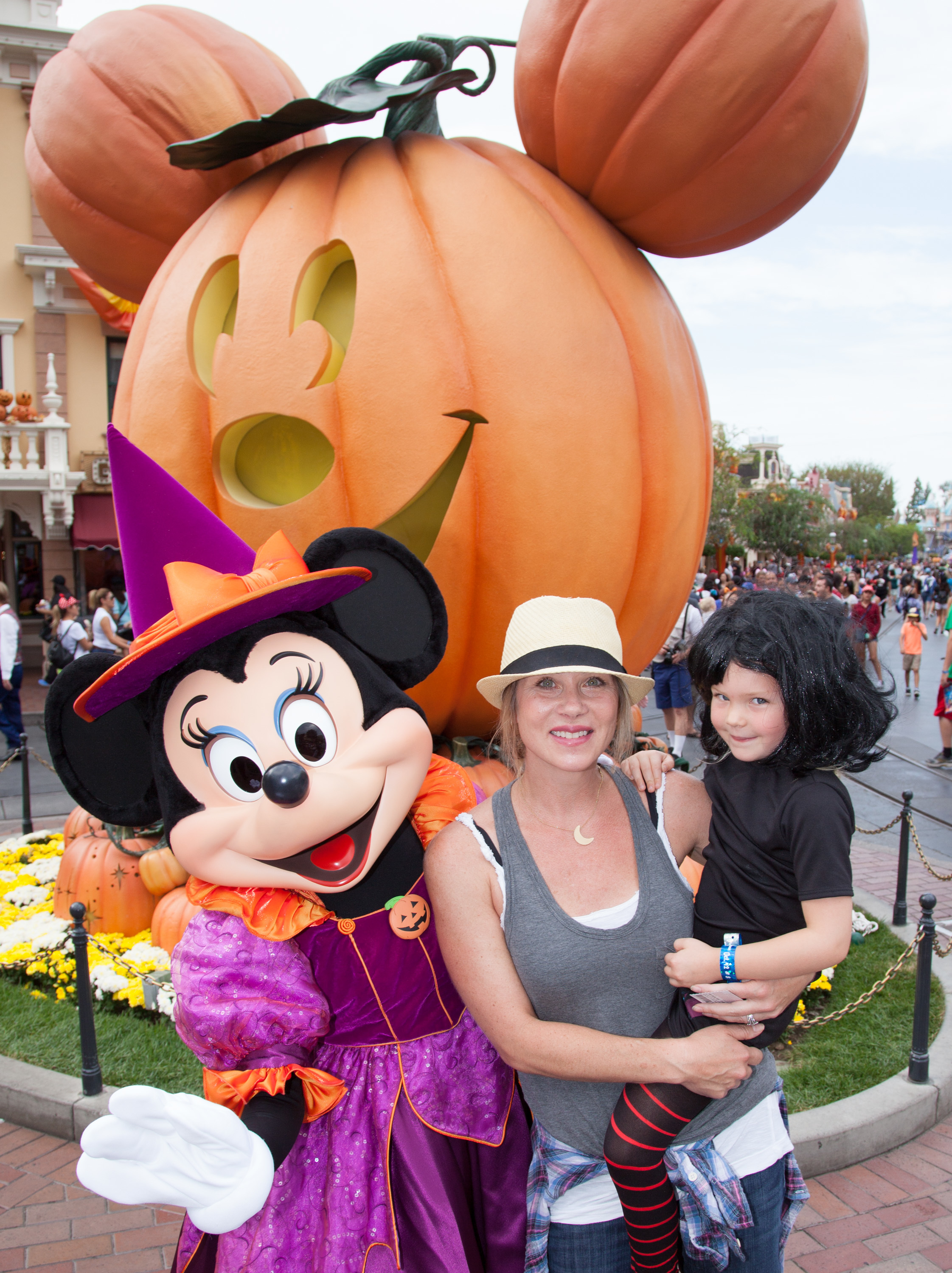 "In this handout photo provided by Disney Parks, Christina Applegate and daughter Sadie LeNoble celebrate ""Halloween Time""  with Minnie Mouse at Disneyland in Anaheim, California on Oct. 12, 2015."