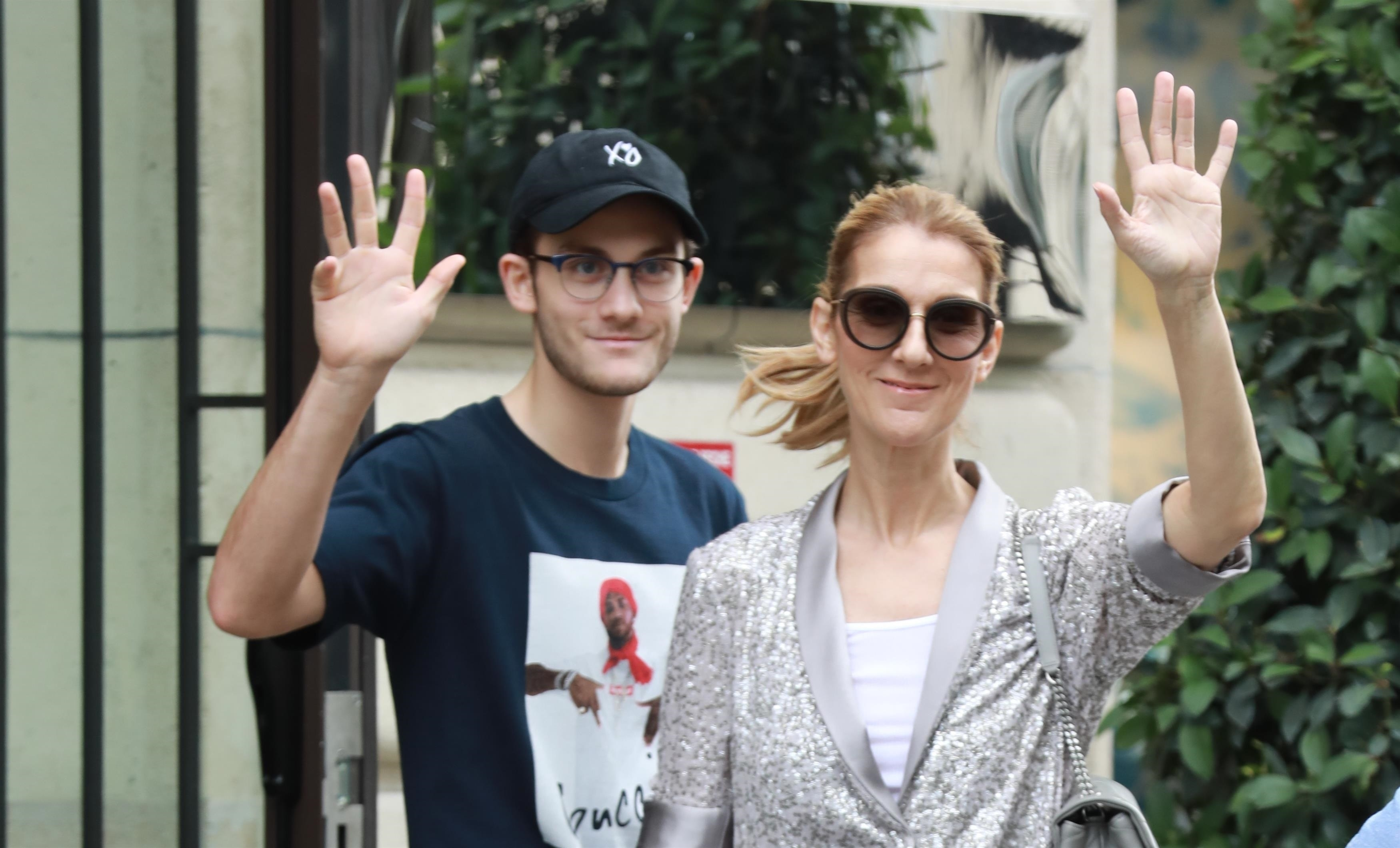 Celine Dion and her son Rene Charles Angelil leave the Royal Monceau hotel in Paris on July 19, 2017.