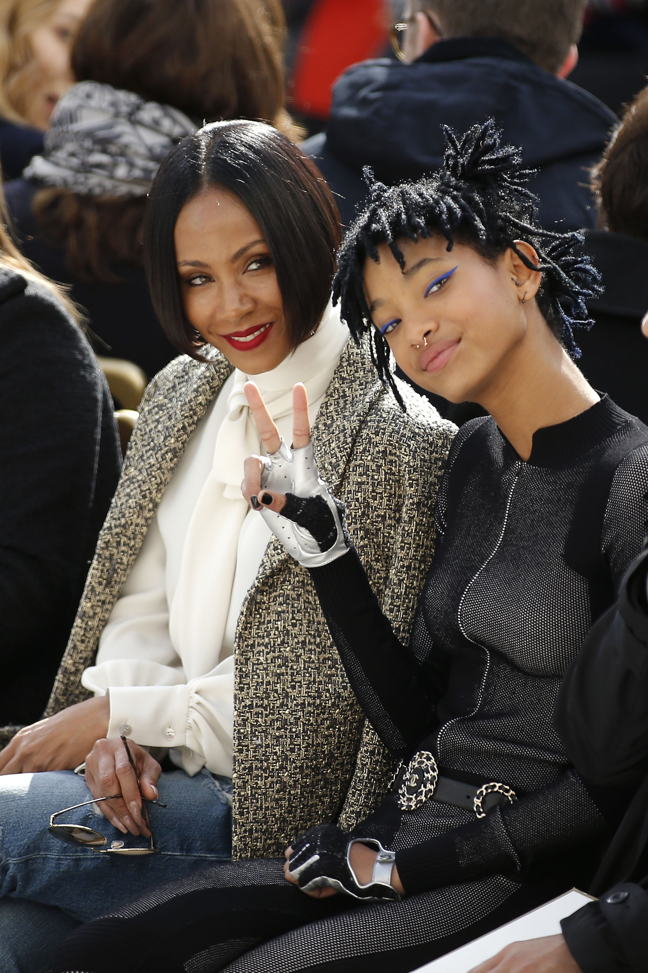 Jada Pinkett Smith and Willow Smith sit in the front row at the Chanel Fashion Show in Paris on March 8, 2016.